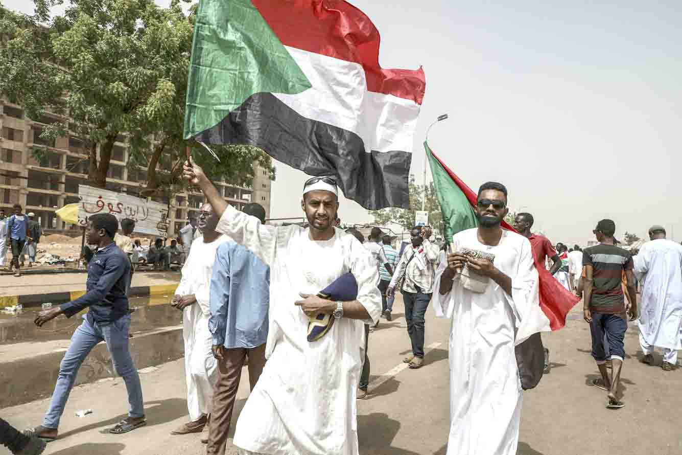 Winds of change. Sudanese protesters rally outside the army headquarters in Khartoum, April 19. (AP)