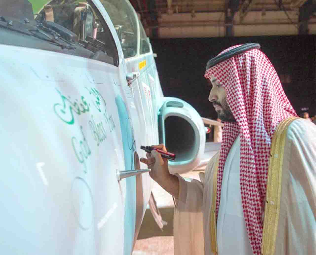 Saudi Crown Prince Mohammed bin Salman bin Abdulaziz inscribes his signature on the first Saudi-built Hawk aircraft at the launching event in Dhahran, March 31. (SPA)