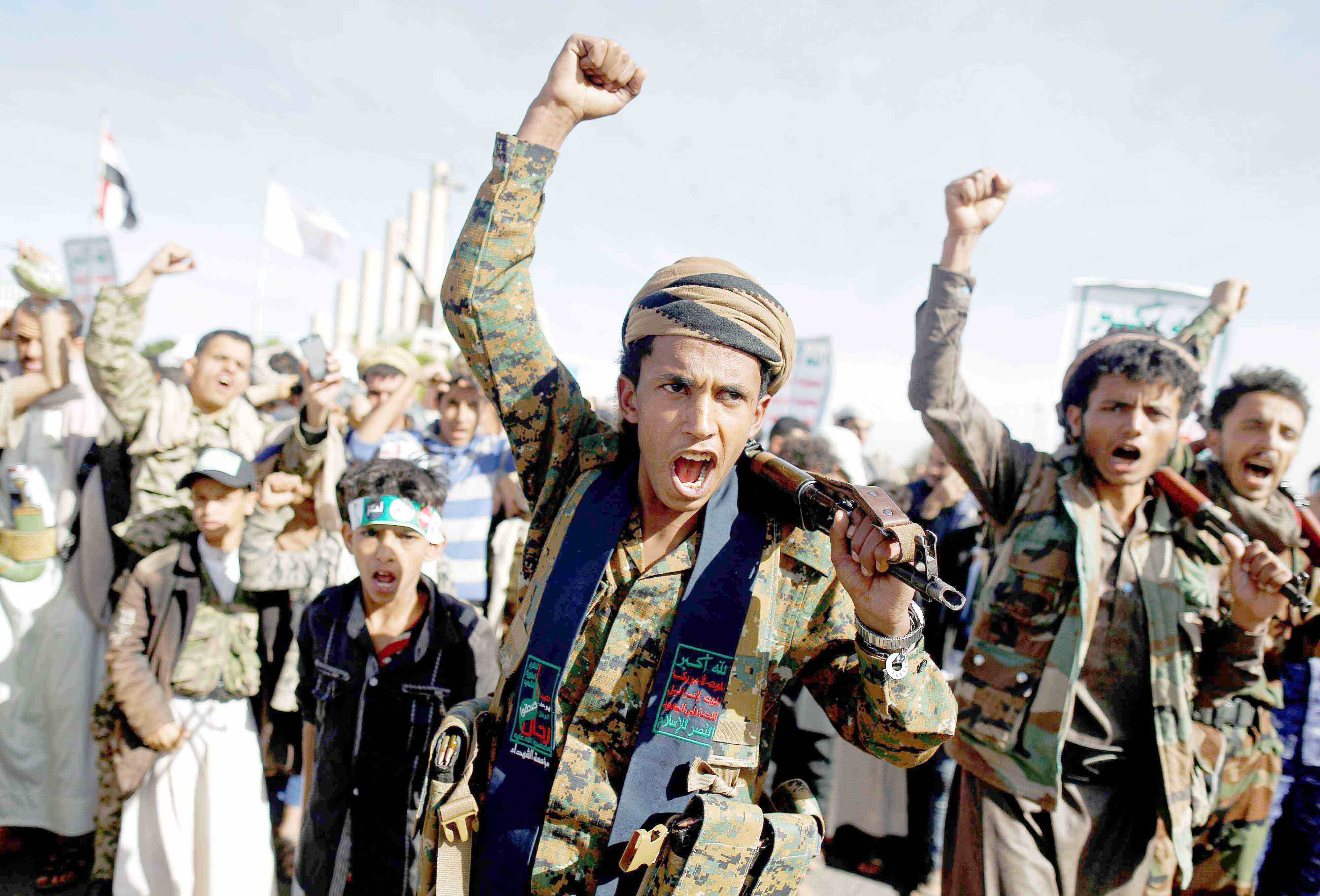 Houthi fighters shout slogans as they attend a rally in Sanaa, March 26. (Reuters)