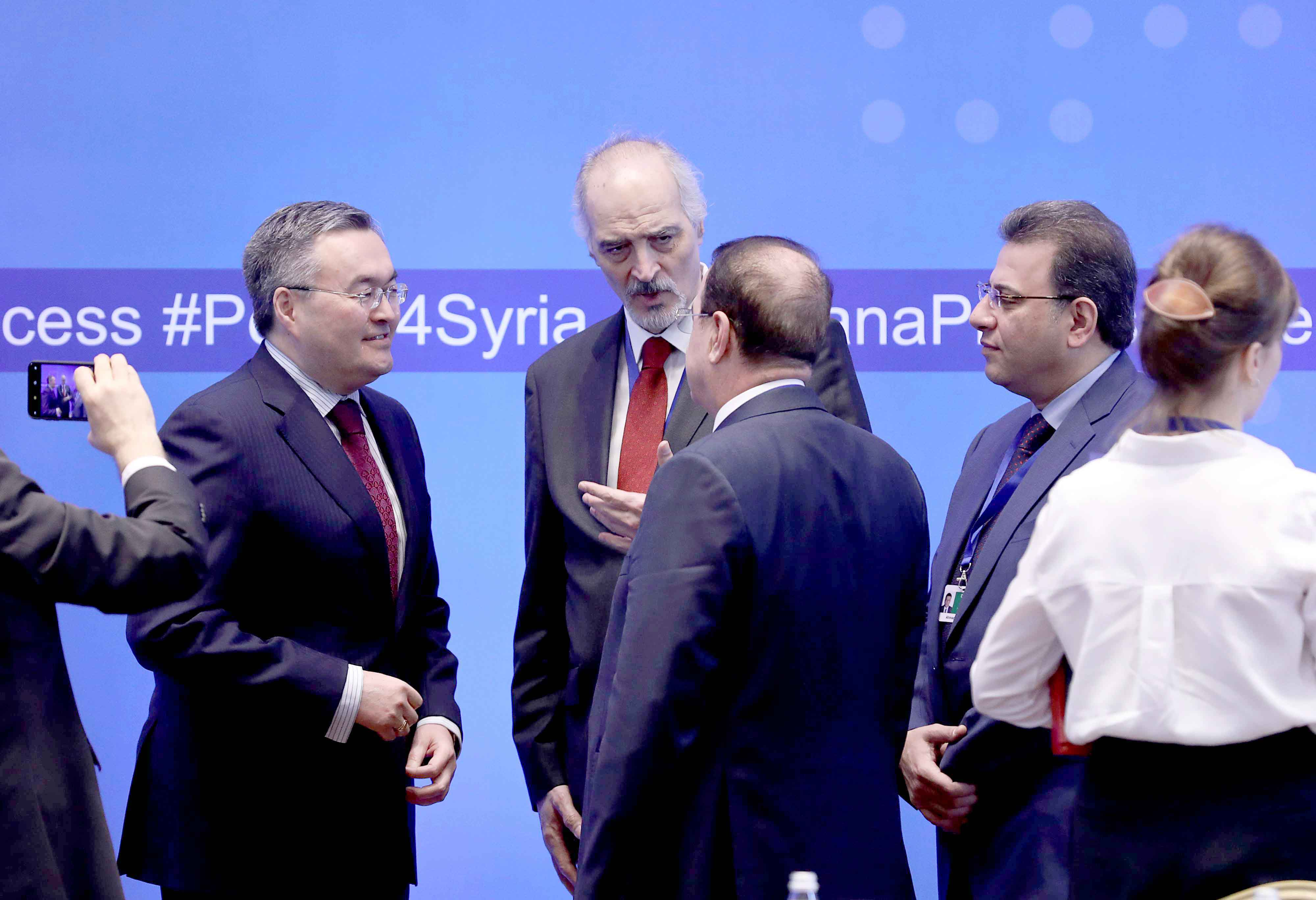 Syria's UN Ambassador Bashar Jaafari (C) speaks with other participants during a session of the peace talks on Syria in Nur-Sultan, April 26. (Reuters)