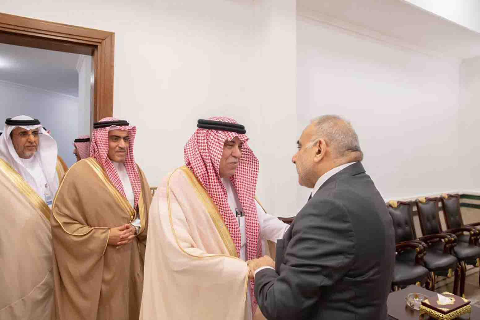 Iraqi Prime Minister Adel Abdul-Mahdi (R) receives Saudi Minister of Commerce and Investment  Majid bin  Abdullah  al-Qasabi (2-R) prior to their meeting in  Baghdad,  March 15. (SPA)
