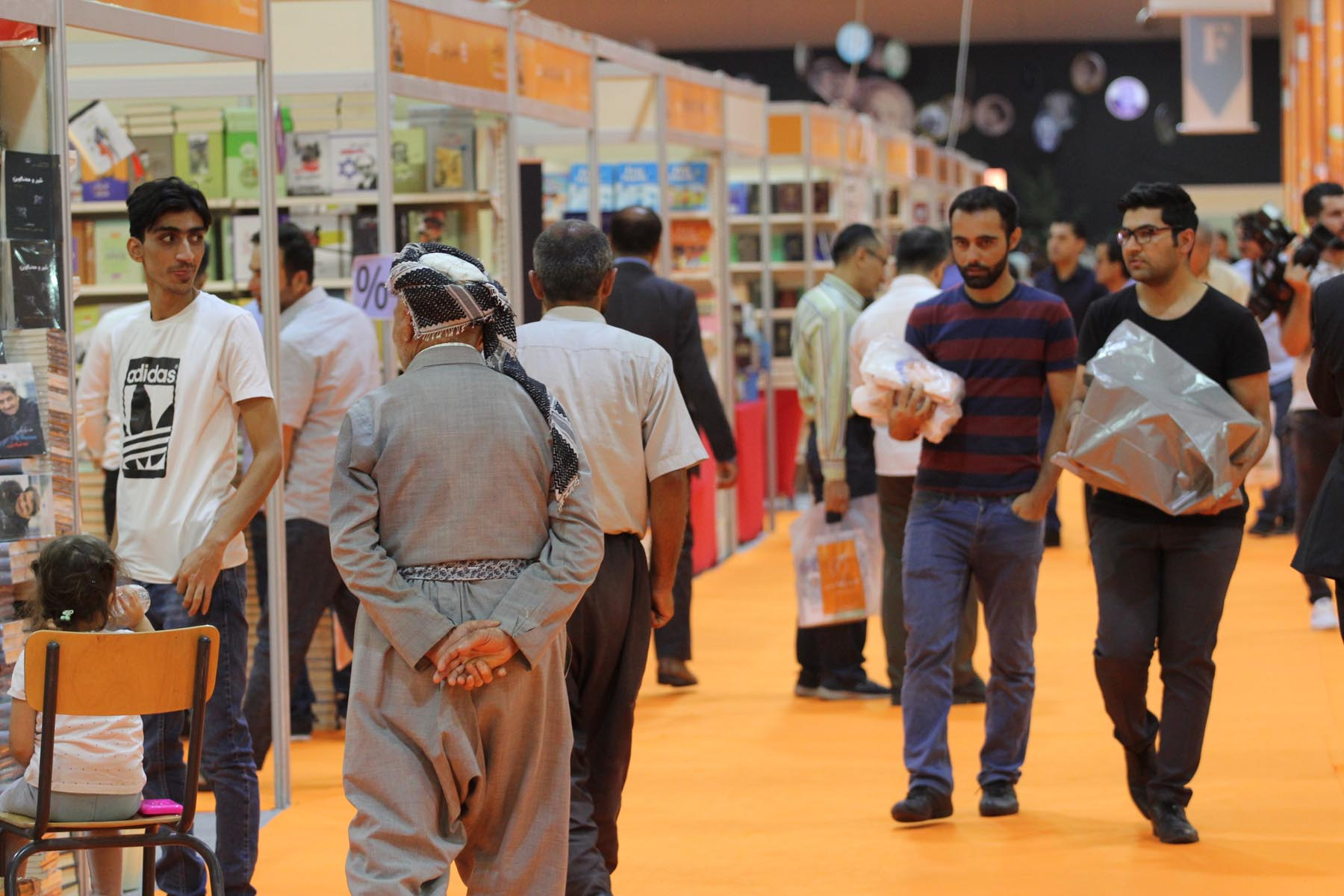 Visitors tour sections of the Erbil International Book Fair. (Twitter)