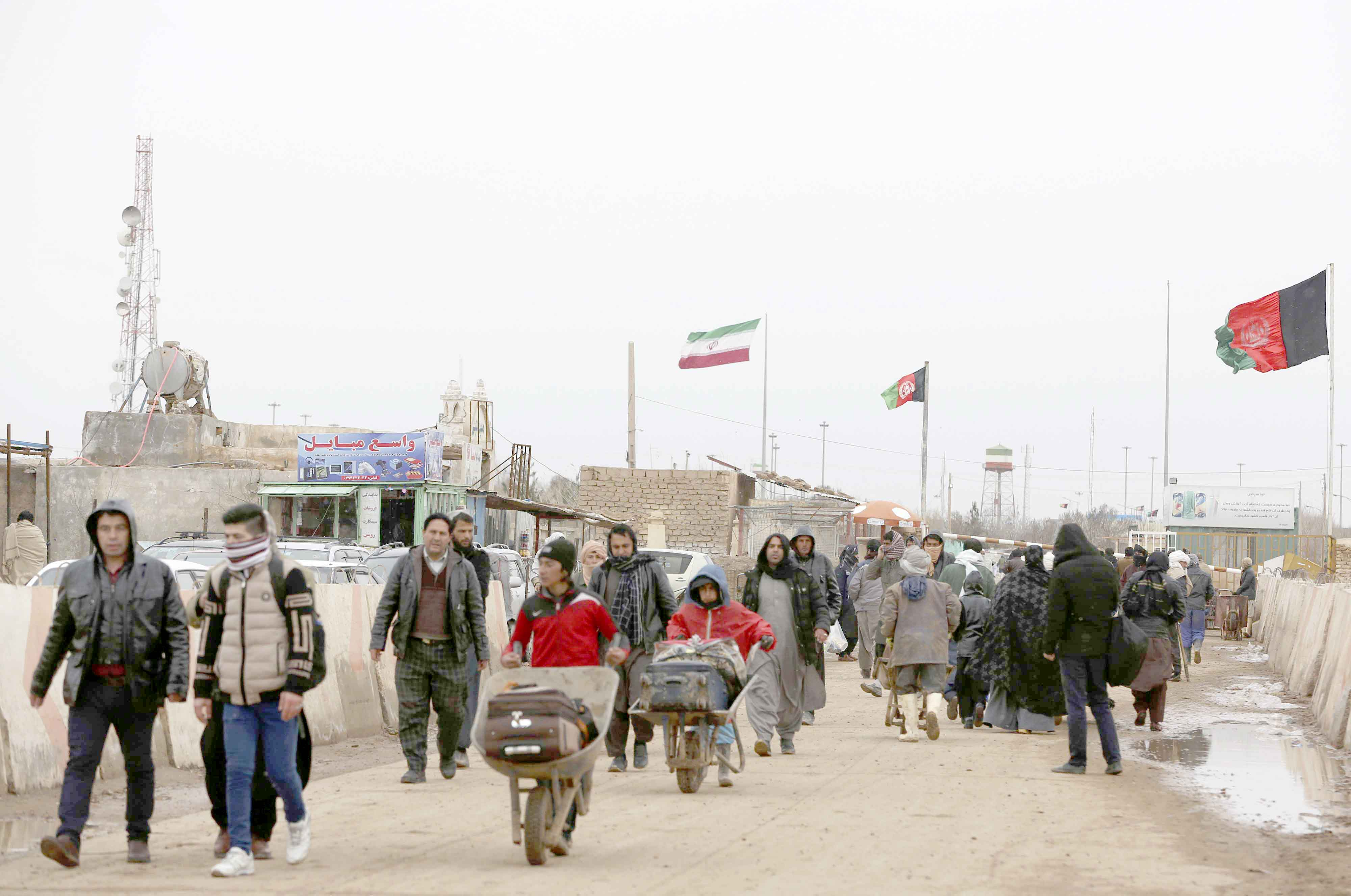 A swirl of suspicion. Afghans return home at the Islam Qala border with Iran in the Herat province, last February. (AP)
