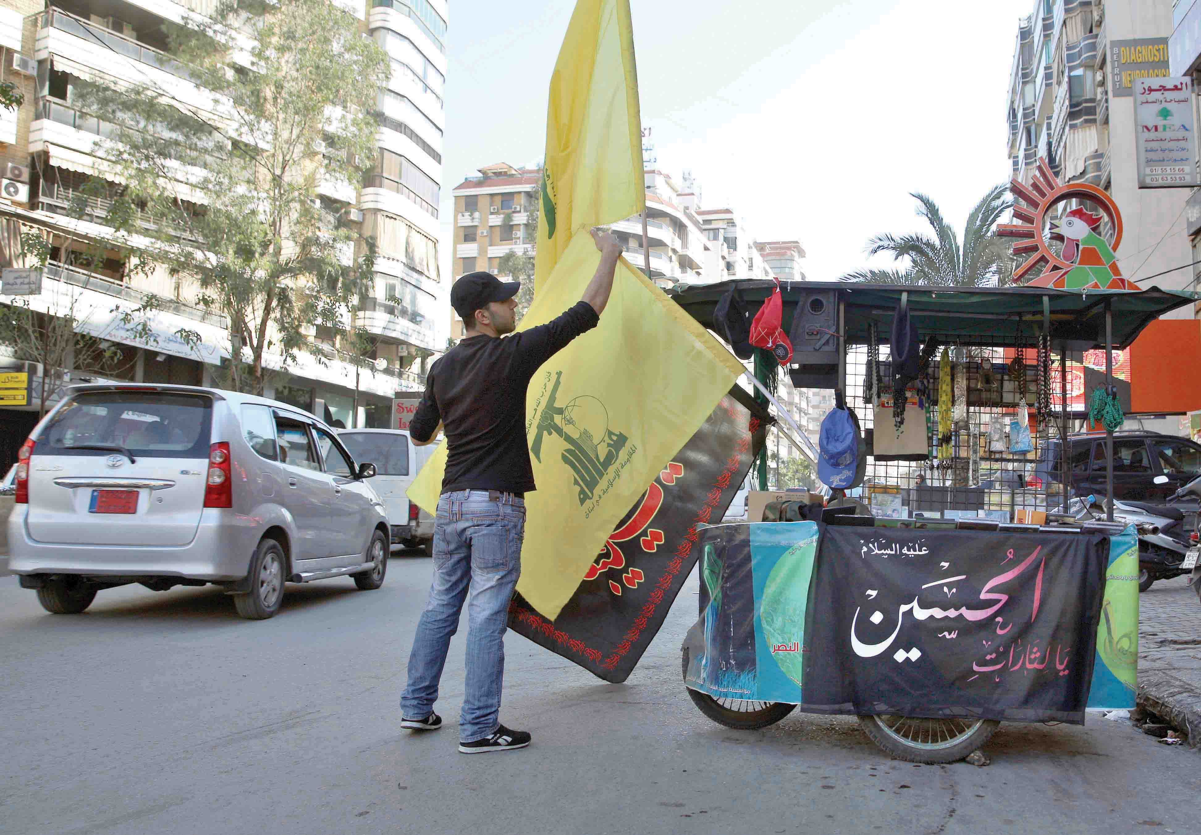 Tough times. A vendor sells Hezbollah and religious flags and other memorabilia in the southern suburbs of Beirut.(AP)
