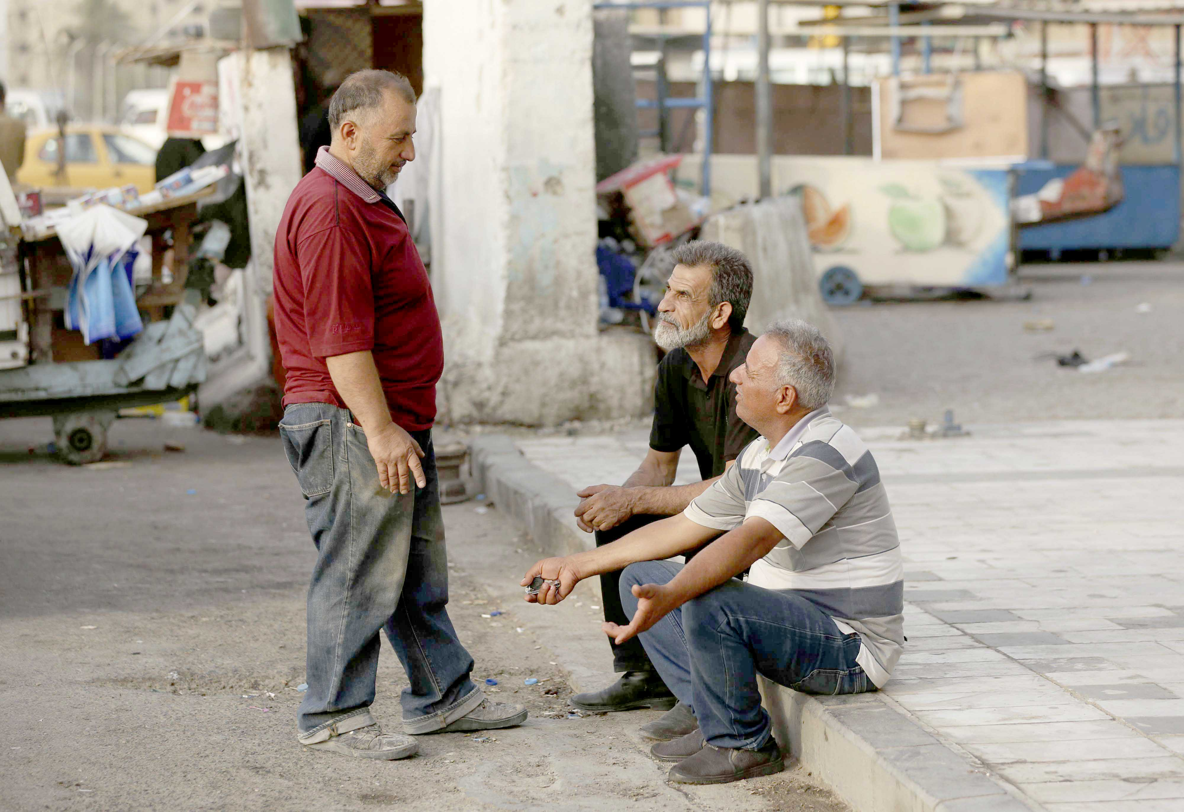 Disenchantment. Unemployed men looking for jobs in Baghdad.(AP)