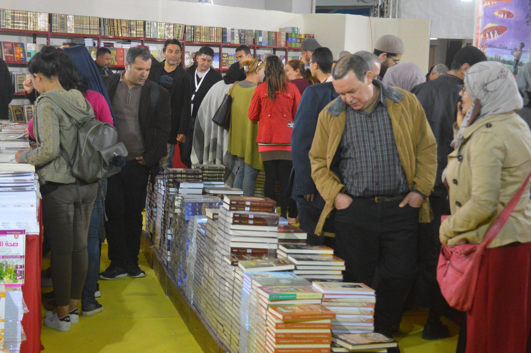 Visitors look at books at the 35th International Book Fair in Tunis, April 7. (Tunis International Book Fair)