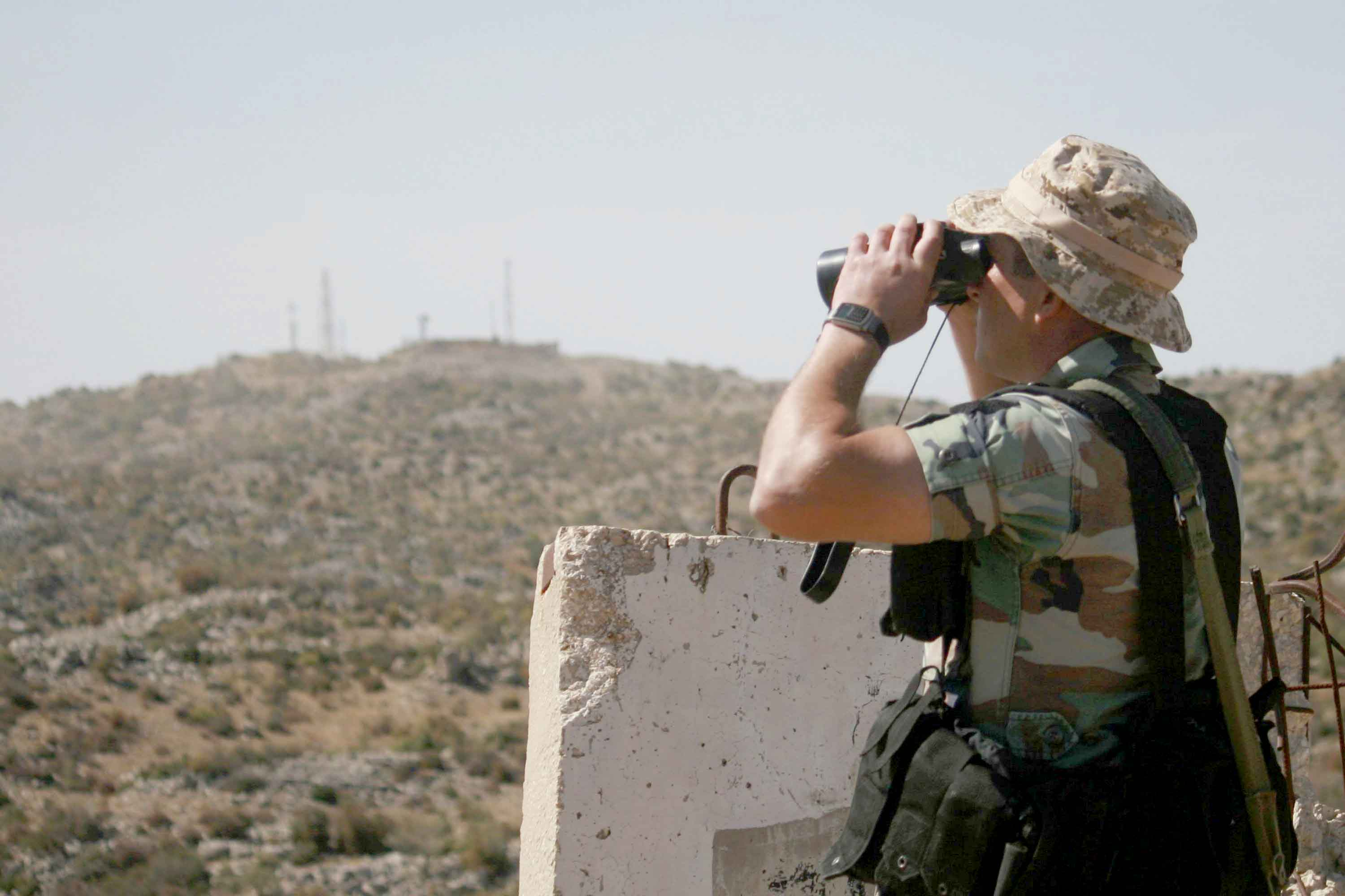 A Lebanese soldier uses a pair of binoculars in the Shebaa area of southern Lebanon as he looks towards a position near the border with Israel. (Reuters)