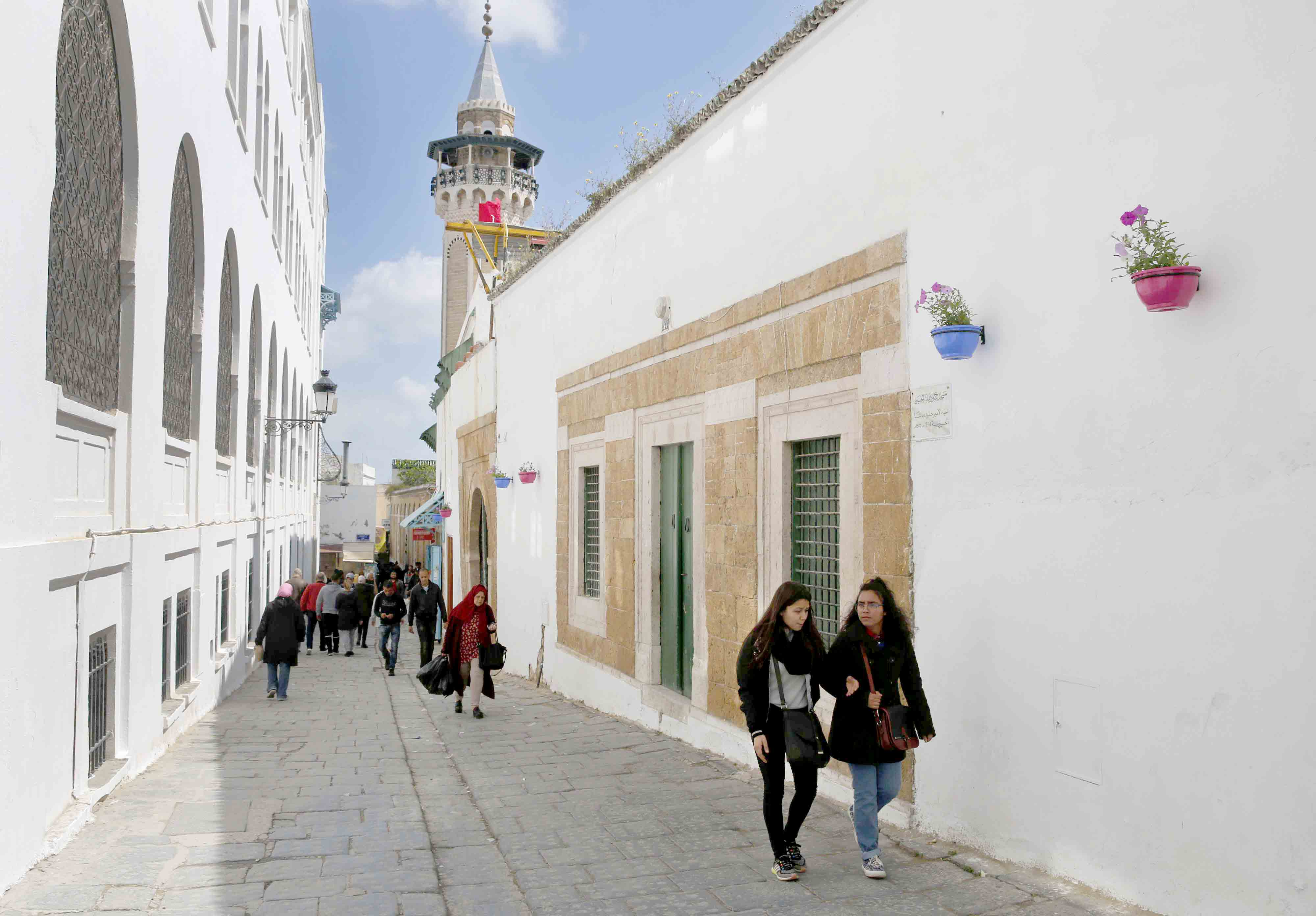 Fading hopes. Tunisians walk at an alley in the old city of Tunis, last March. (AP)