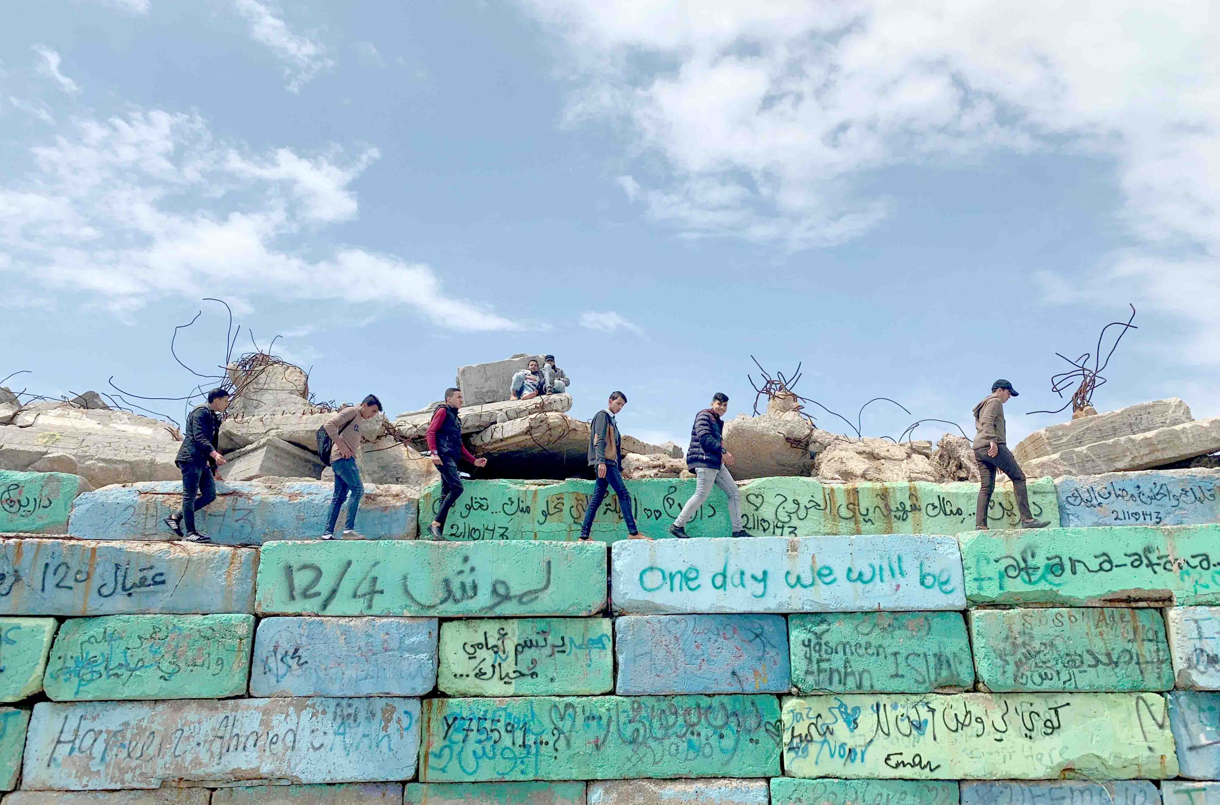 Palestinians walk on concrete blocks at the seaport of Gaza City, April 2. (Reuters)