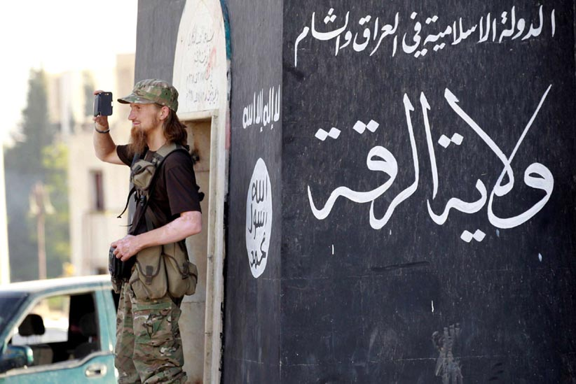 Stubborn threat. A 2014 file photo shows an Islamic State militant in Syria's northern Raqqa province.      (Reuters)