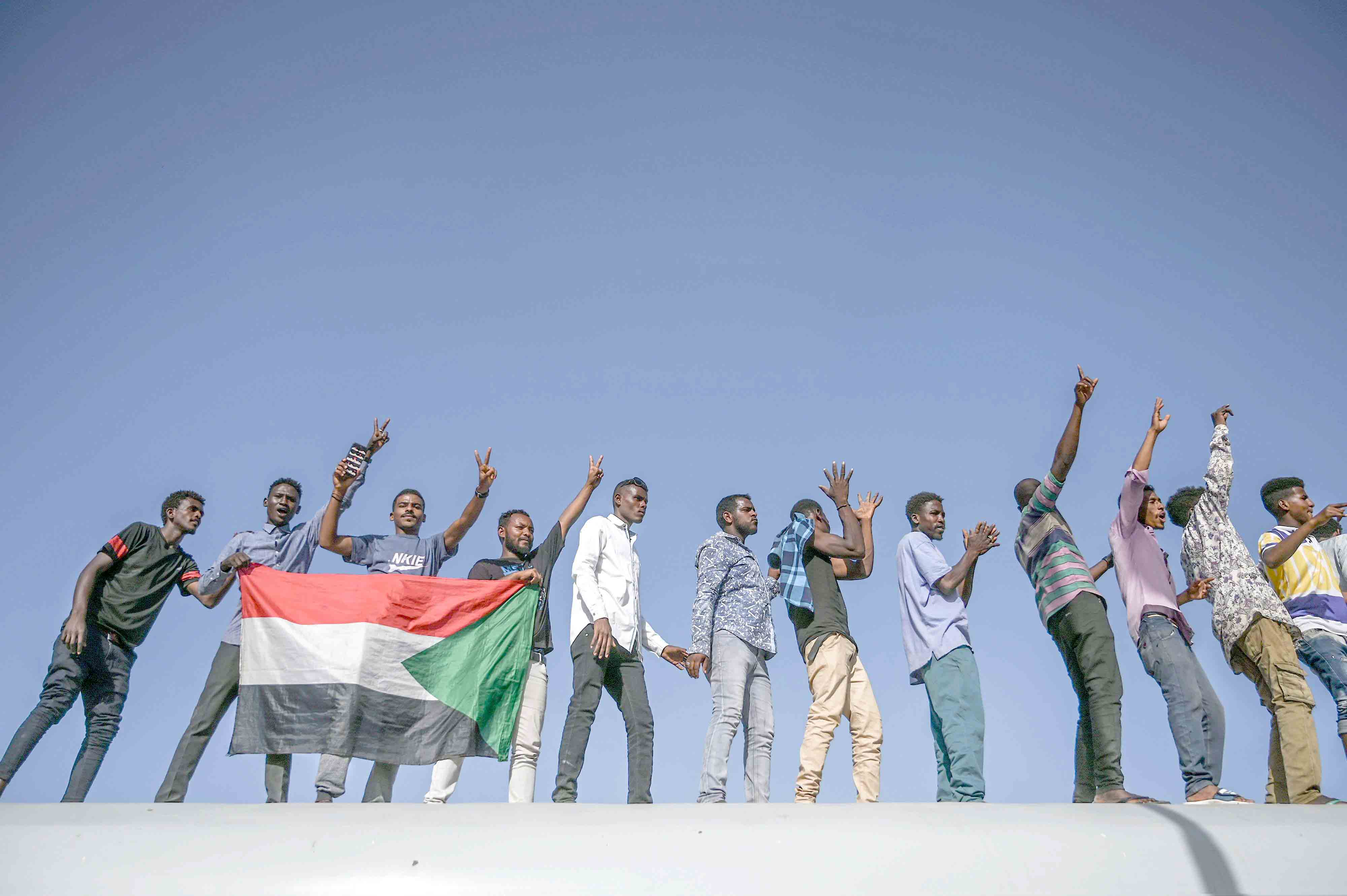 Sudanese protesters from the city of Atbara flash the victory sign in Khartoum, April 23. (AFP)