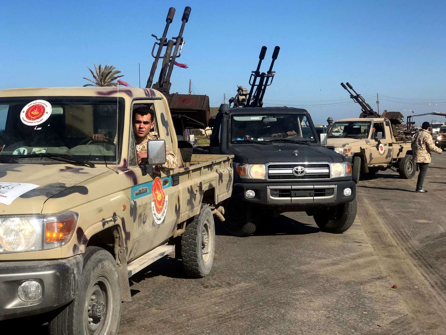 Forces loyal to Libya's UN-backed unity government arrive in Tajura, a coastal suburb of the Libyan capital Tripoli, on April 6, 2019. (AFP)