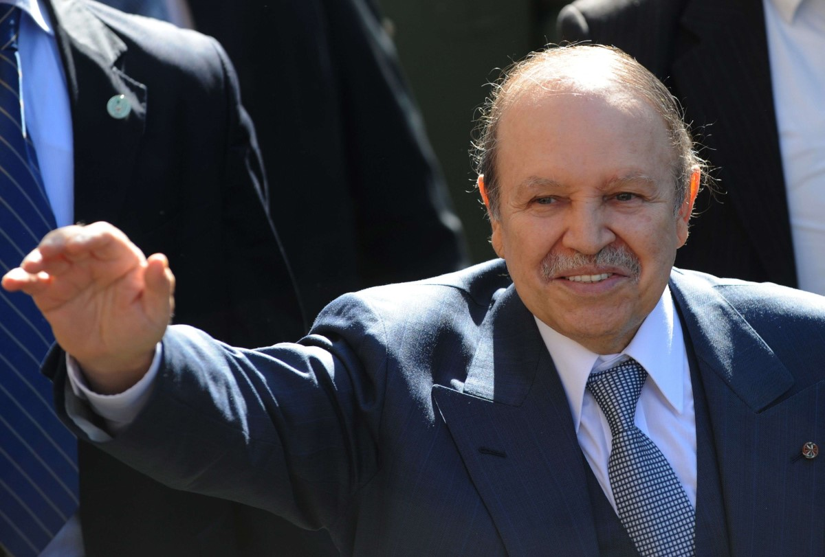 In this file photo taken on February 18, 2009 Algerian President Abdelazziz Bouteflika waves at supporters during his visit to Blida, south of Algiers. (AFP)