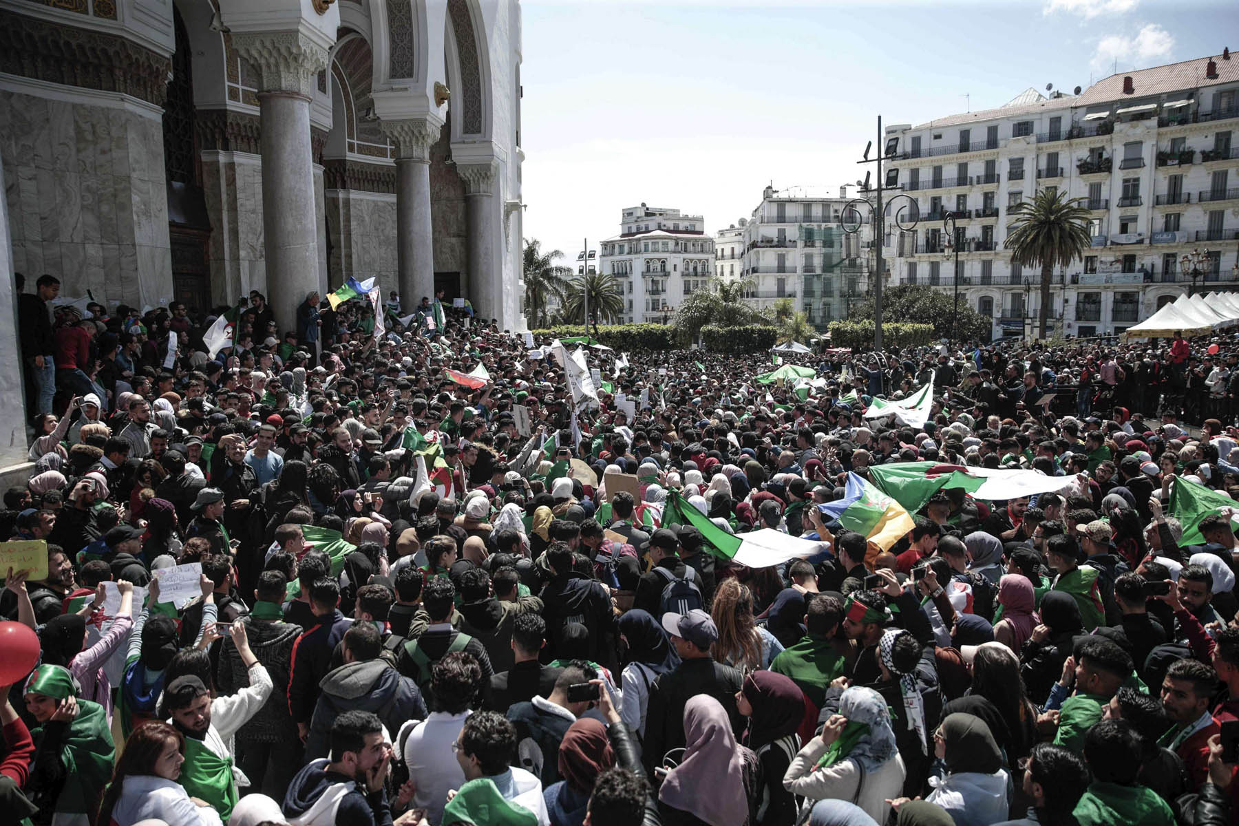 Students wave flags and chant slogans during a demonstration in Algiers, Algeria, Tuesday, April 9, 2019. (AP)