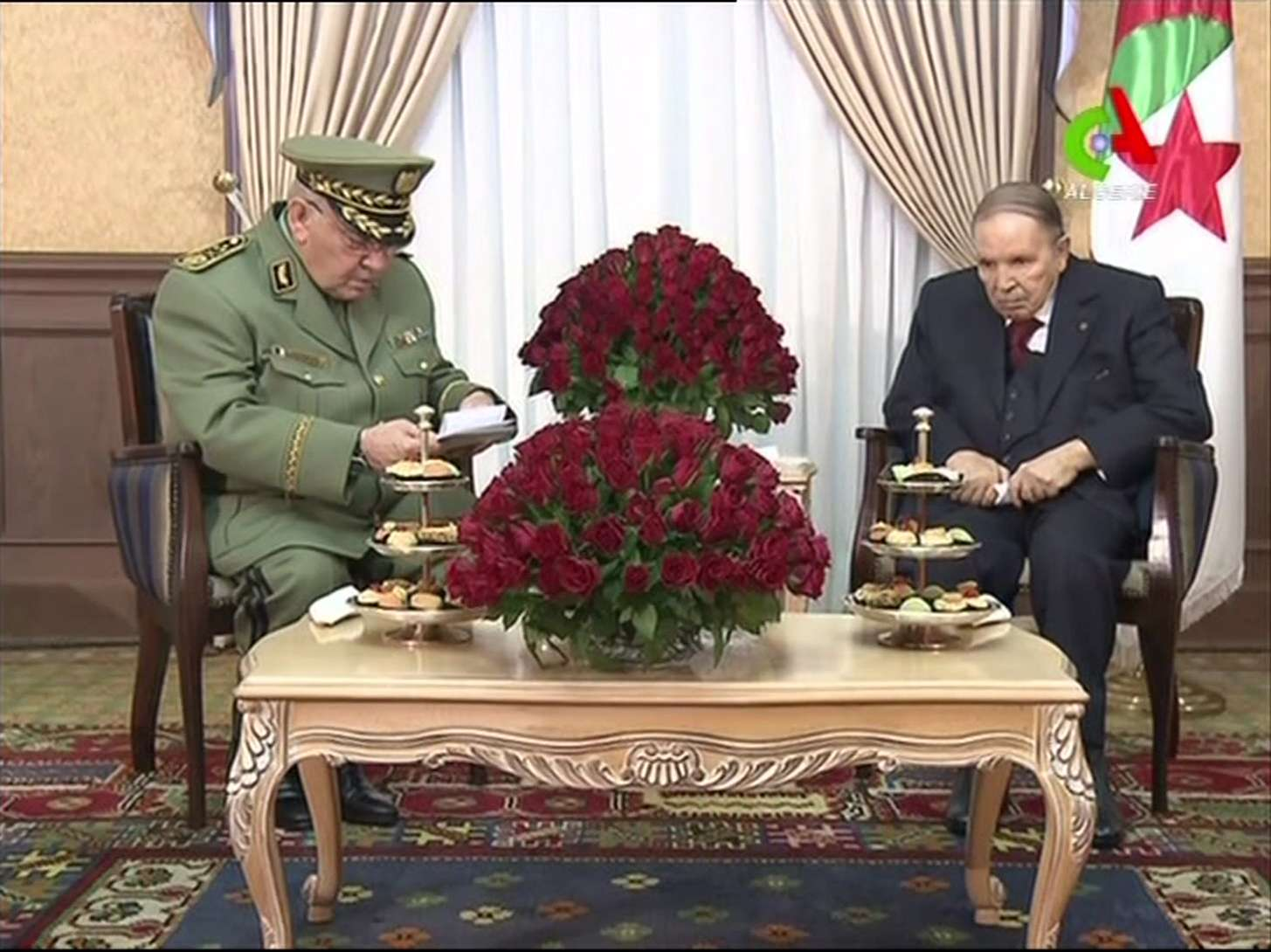 "A file video grab taken from footage broadcast by Algeria's ""Canal Algerie"" on March 11, 2019 shows Algerian President Abdelaziz Bouteflika (R) meeting with Algeria's army chief, Ahmed Gaid Salah. (AFP)"