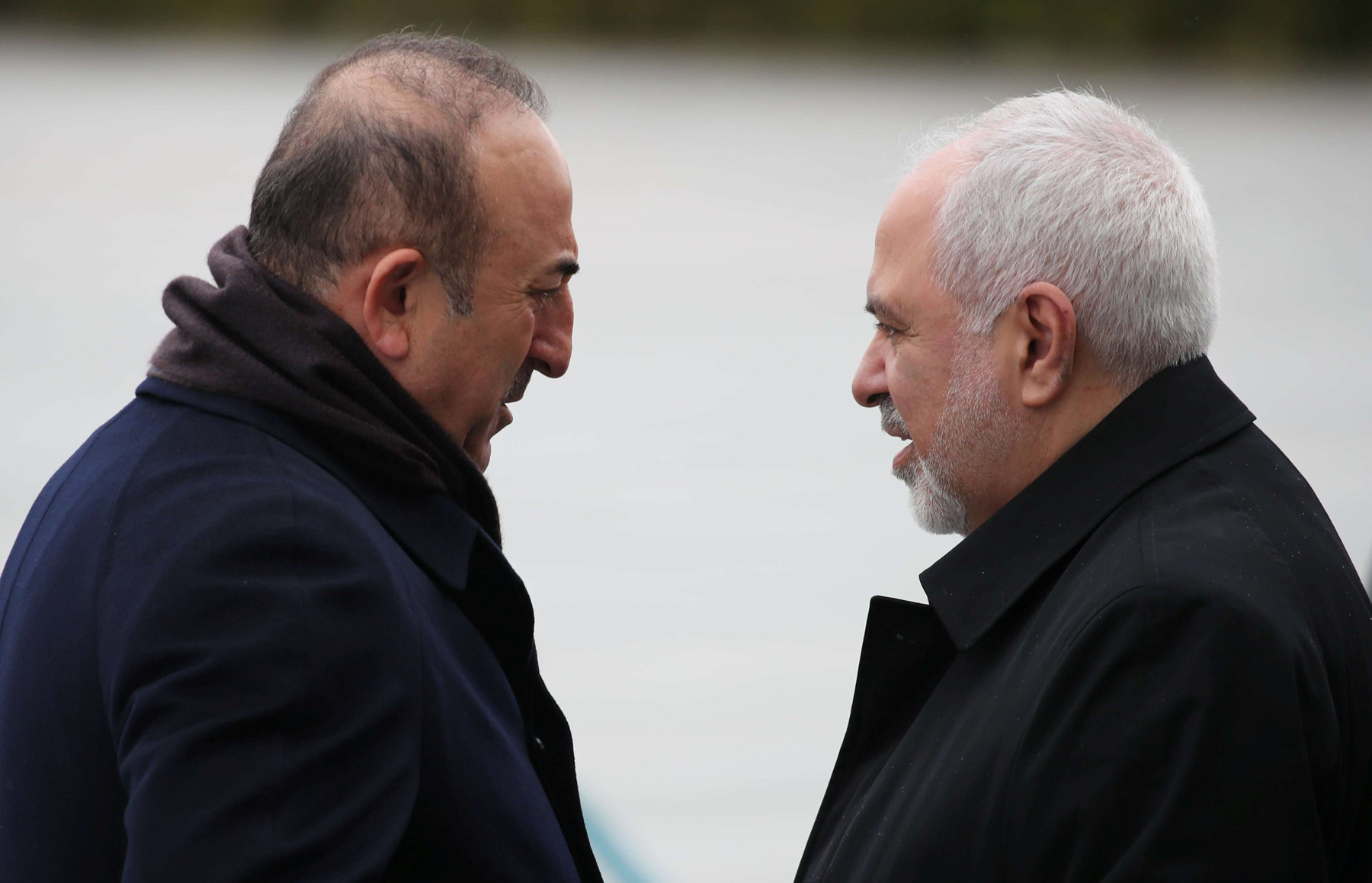 In the same trench. Turkish Foreign Minister Mevlut Cavusoglu (L) and his Iranian counterpart Mohammad Javad Zarif, chat in the presidential palace in Ankara, last December. (Reuters)
