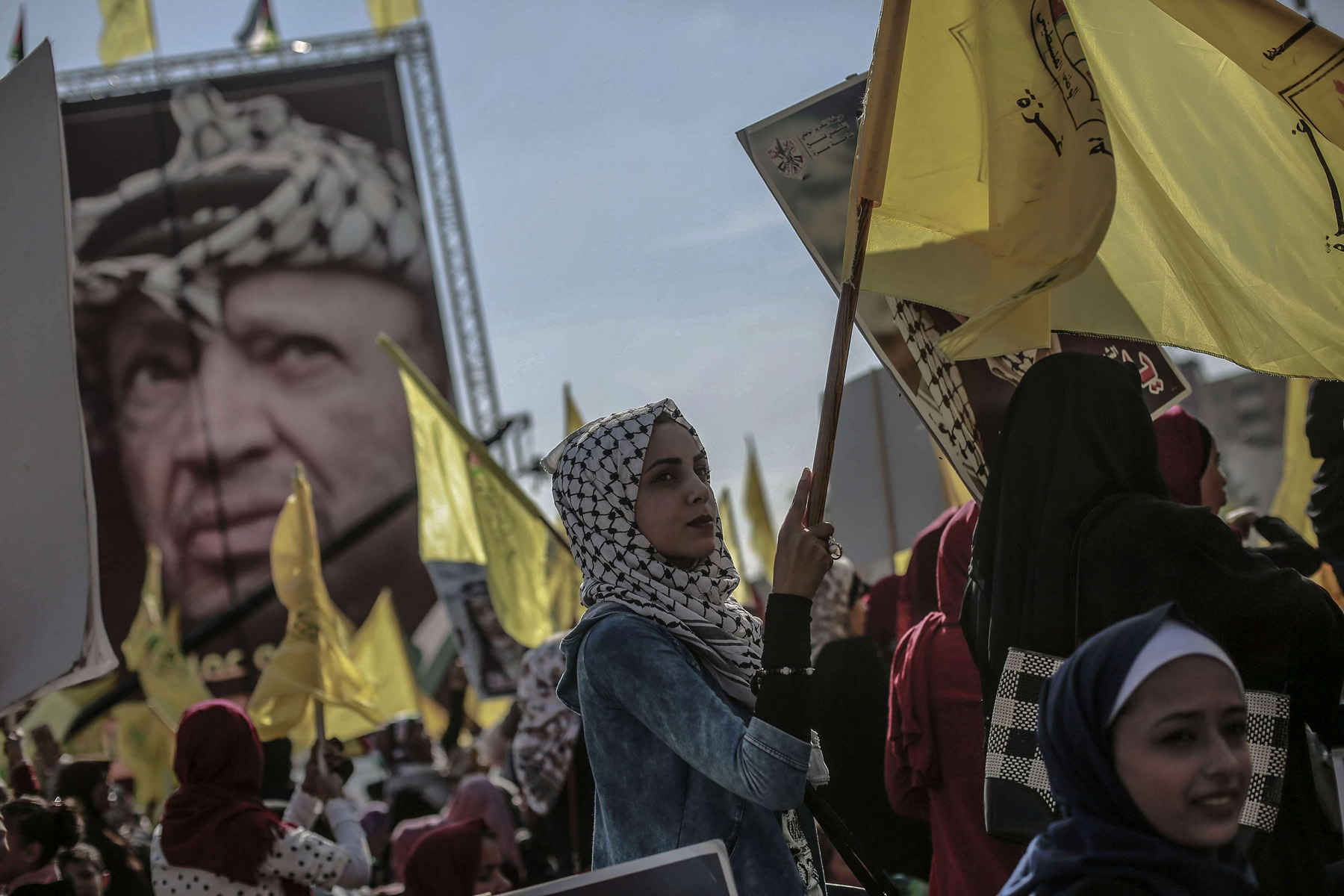 A return to the basics. Palestinian Fatah supporters take part in a rally with a poster of late leader Yasser Arafat in the background, last November. (dpa)