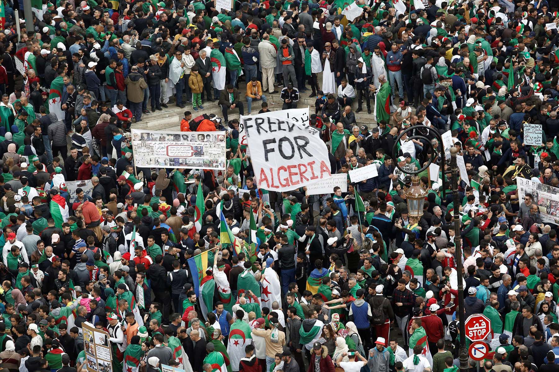 Algerian demonstrators hold banners as they return to the streets to press demands for wholesale democratic change well beyond former president Abdelaziz Bouteflika's resignation, in Algiers, April 19, 2019. (Reuters)