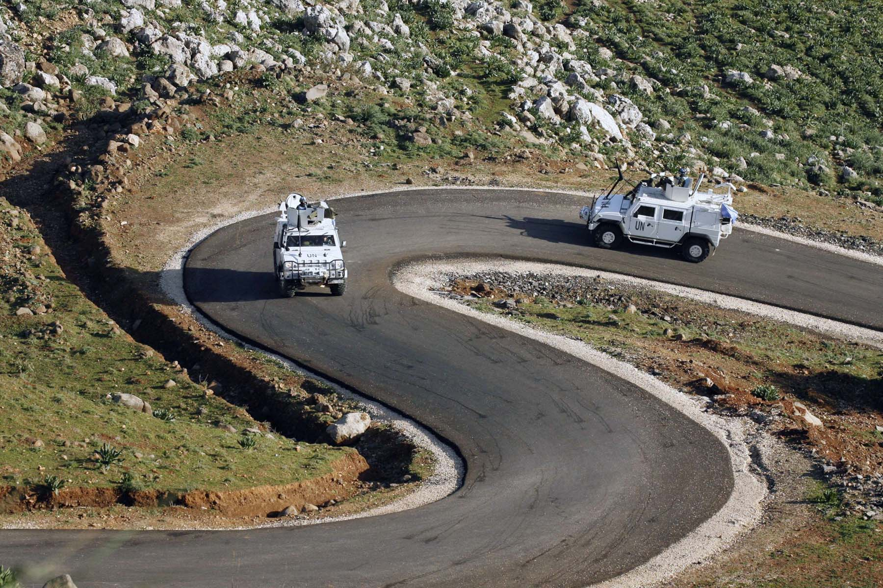 A winding path. Peacekeepers of the UN Interim Force in Lebanon drive their vehicles on a road near al-Majidiyah in southern Lebanon.  (AFP)