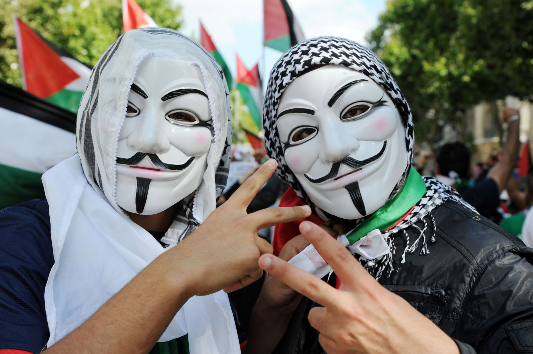Digital resistance. Pro-Palestinian activists wearing Guy Fawkes masks take part in a demonstration in Paris.                                   (AFP)