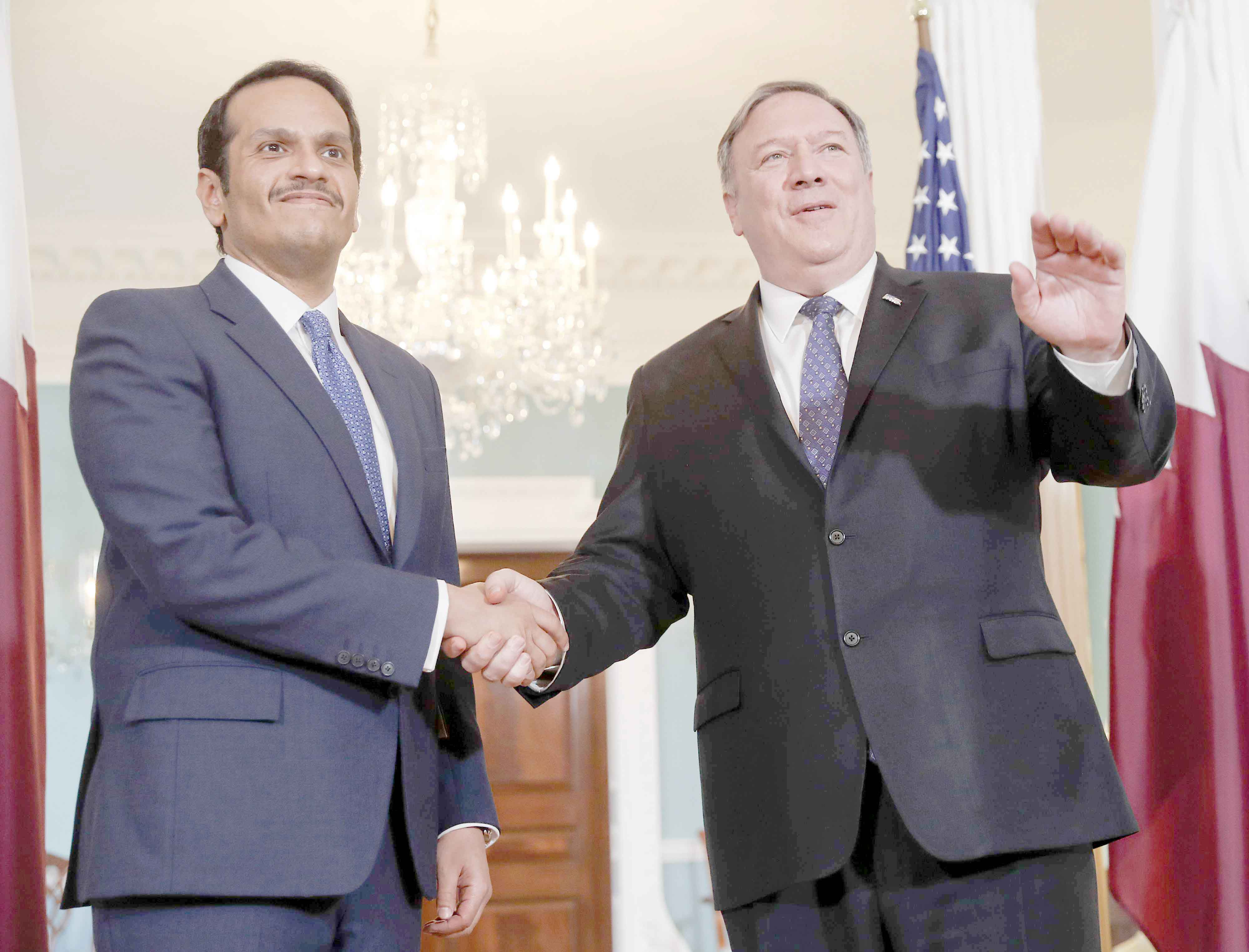 US Secretary of State Mike Pompeo (R) and Qatari Foreign Minister Sheikh Mohammed bin Abdulrahman al-Thani at the State Department in Washington, last April. (AP)