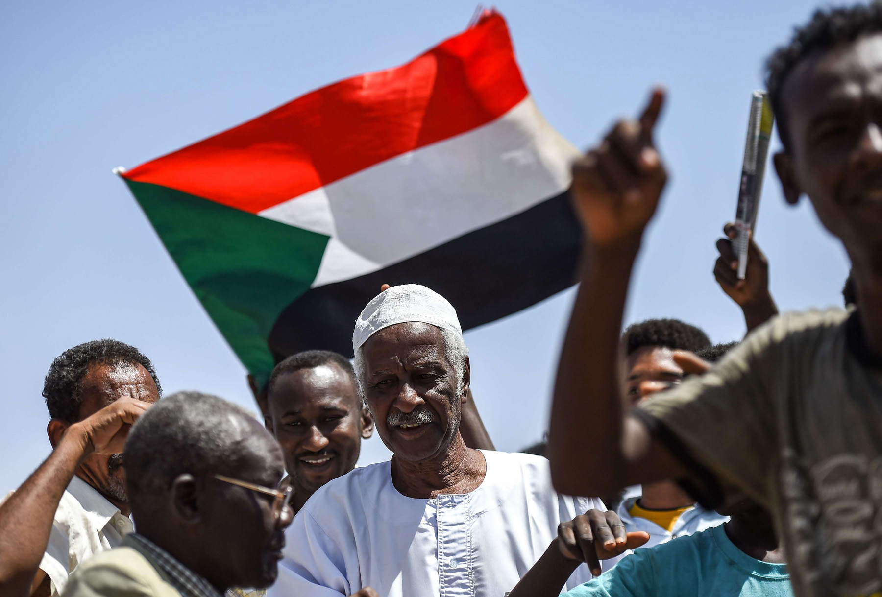 Sudanese protesters chant slogans in Khartoum, May 14, one day  after an attack by security agents loyal to ousted President Omar al-Bashir. (AFP)