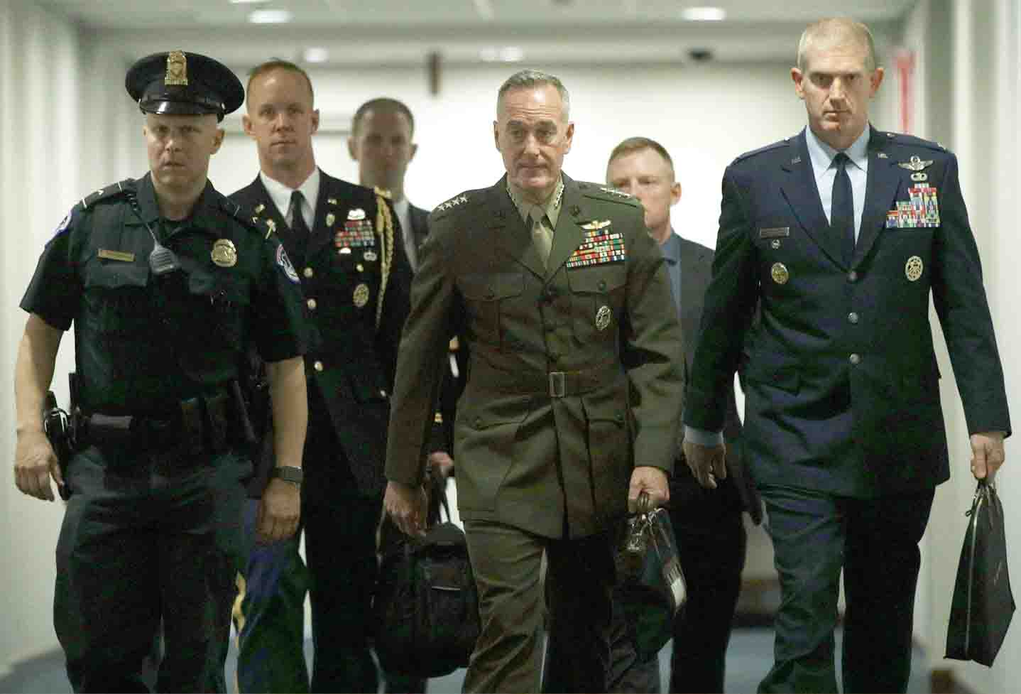 Uncertain trajectory. Chairman of the Joint Chiefs of Staff General Joseph Dunford (C) arrives at a closed briefing for Senate members in Washington, May 21. (AFP)