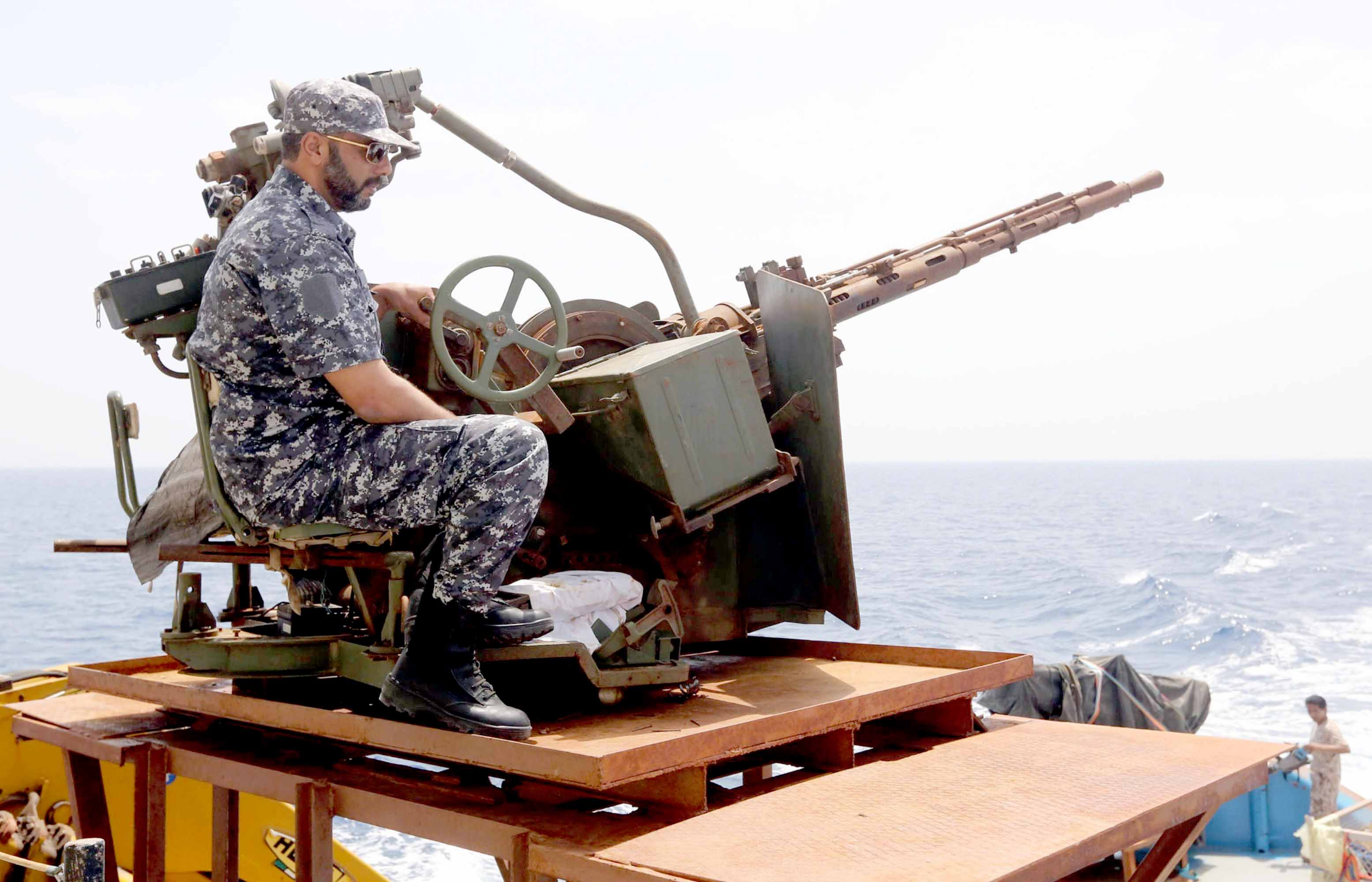 Foreign threats.  A member of the Libyan Coast Guard on patrol off the eastern port city  of Misrata.  (AFP)