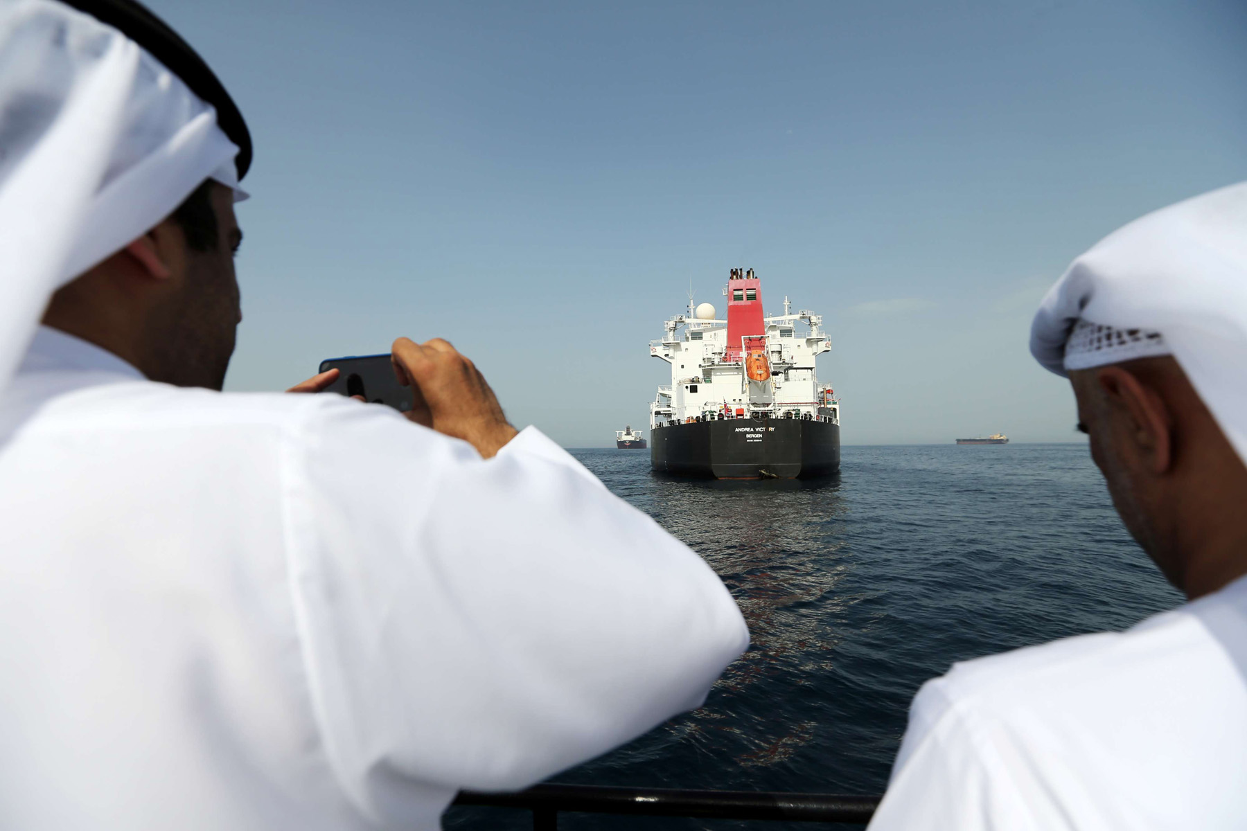 Port officials take a picture of a damaged Andrea Victory ship at the Port of Fujairah, May 13. (Reuters)