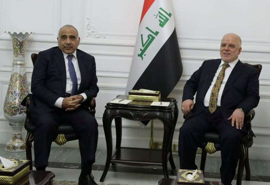 Conflicting interests. A file photo shows Iraqi Prime Minister Adel Abdul-Mahdi (L) speaking with former Prime Minister Haider al-Abadi in Baghdad, last October.  (Reuters)