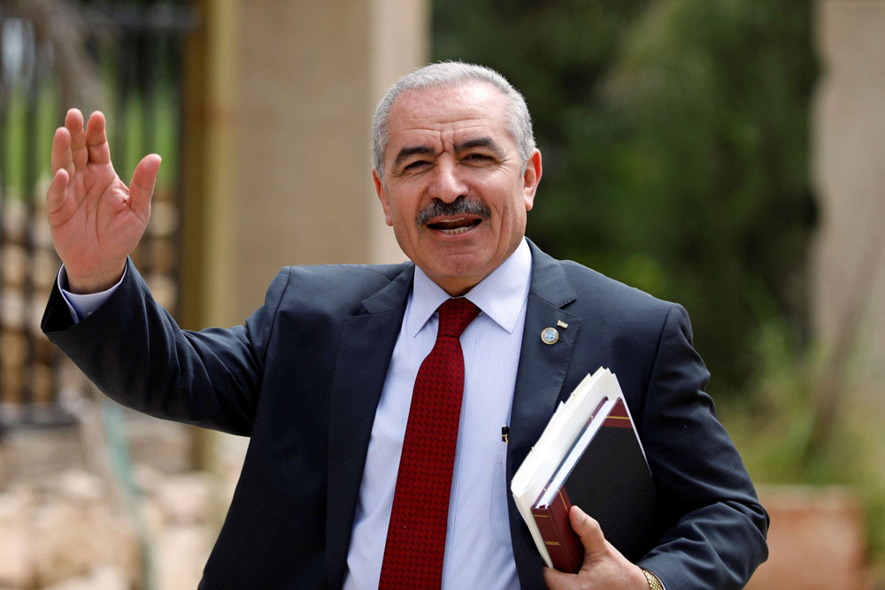 Palestinian Prime Minister Mohammad Shtayyeh gestures as he arrives for a cabinet meeting in Ramallah, in the Israeli-occupied West Bank, April 15. (Reuters)