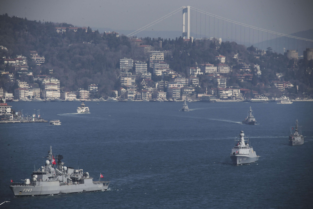 Turkish Navy vessels cross the Bosporus Strait in Istanbul, March 9. (DHA via AP)