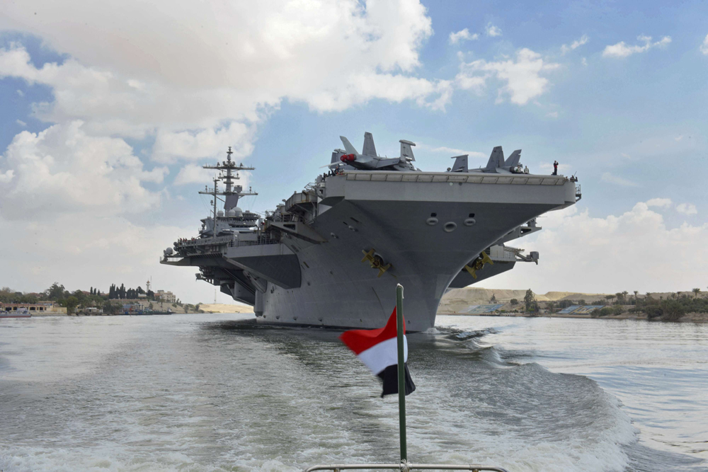 The USS Abraham Lincoln sails south in the Suez Canal near Ismailia, Egypt, May 9. (AP)