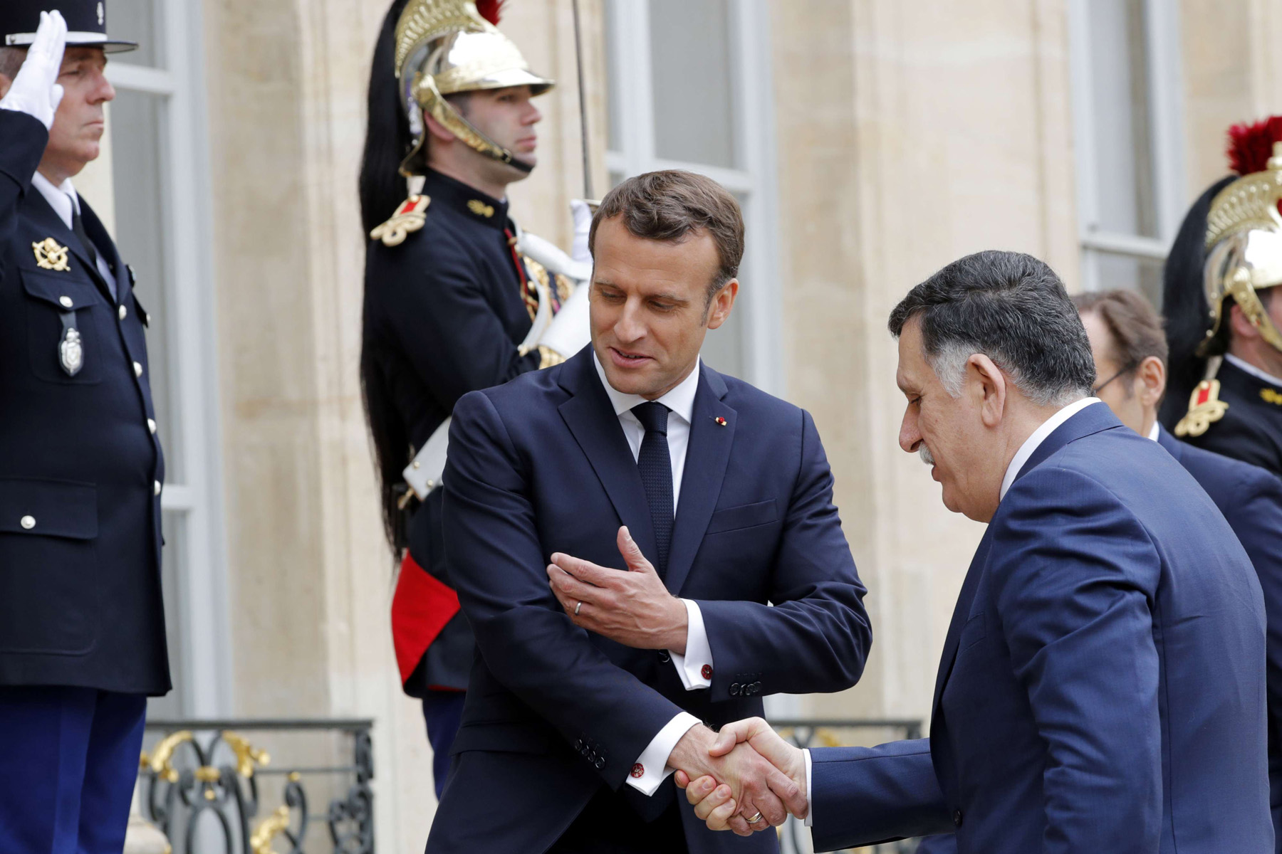 French president Emmanuel Macron meets Libyan Prime Minister Fayez Al-Sarraj, who heads the UN-backed government in Tripoli at the Elysee Palace in Paris, France, May 8, 2019. (Reuters)