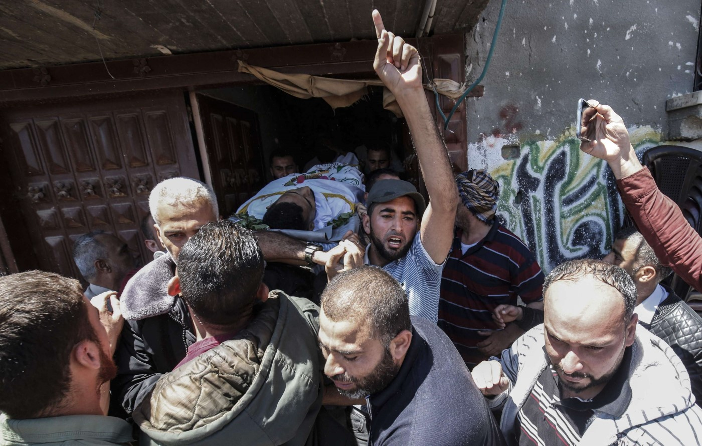 Palestinian mourners carry the body of Abdullah Abd al-Aal, during his funeral in Rafah in the southern Gaza Strip on May 11, 2019. (AFP)