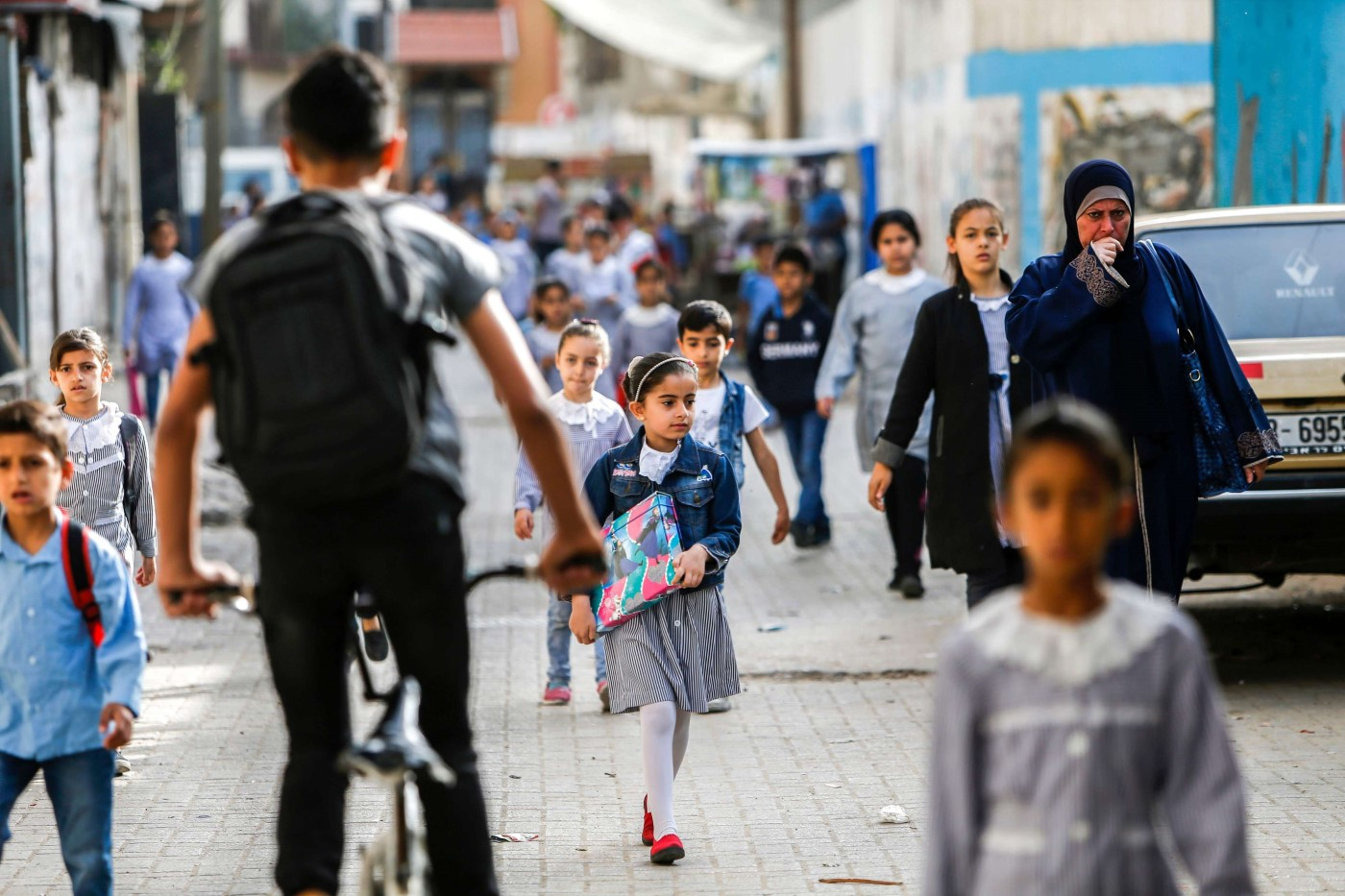 Palestinian students walk on their way to school to attend their end-of-year exams in Gaza City on May 23, 2019. (AFP)