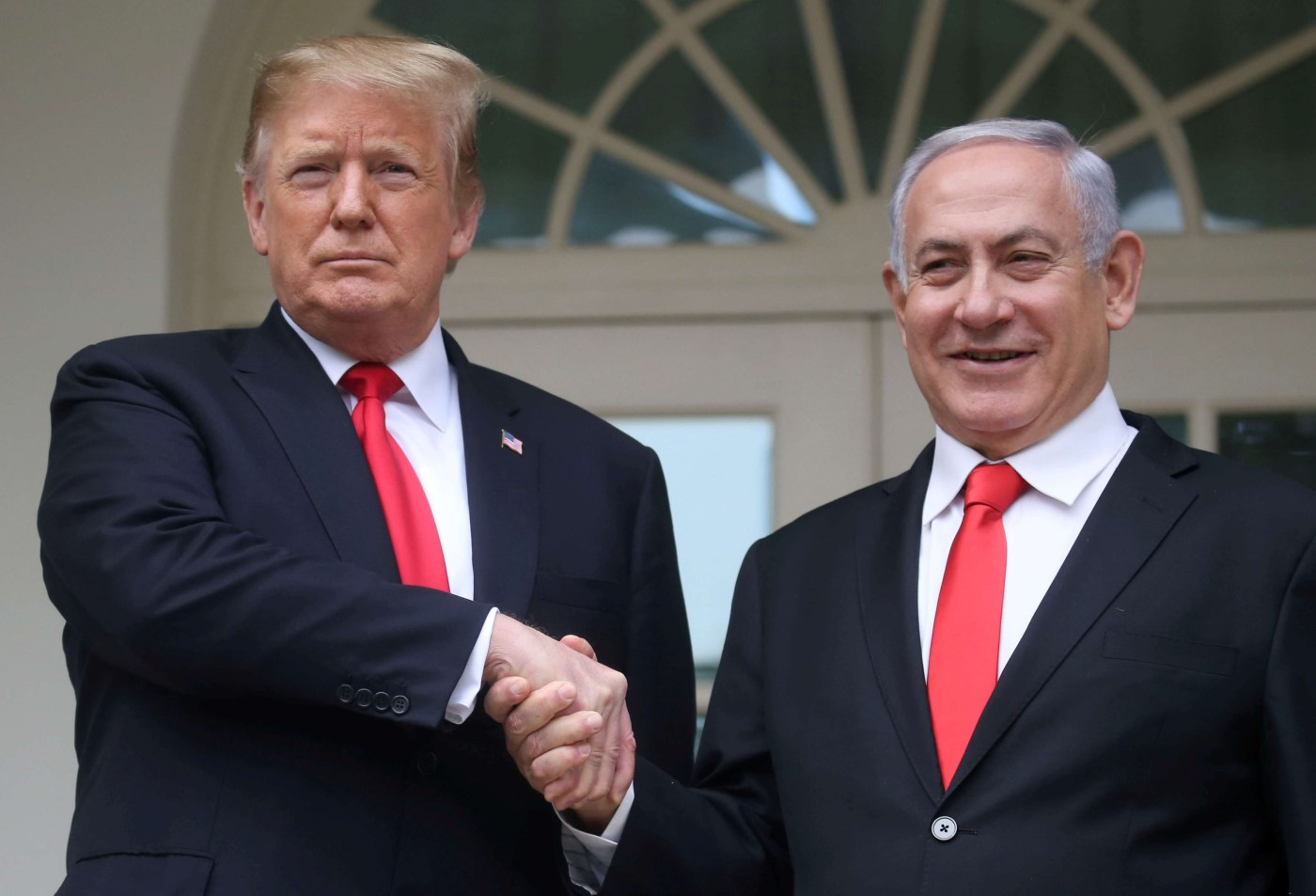 US President Donald Trump shakes hands with Israel's Prime Minister Benjamin Netanyahu as they pose on the West Wing colonnade in the Rose Garden at the White House in Washington, US, March 25, 2019. (Reuters)