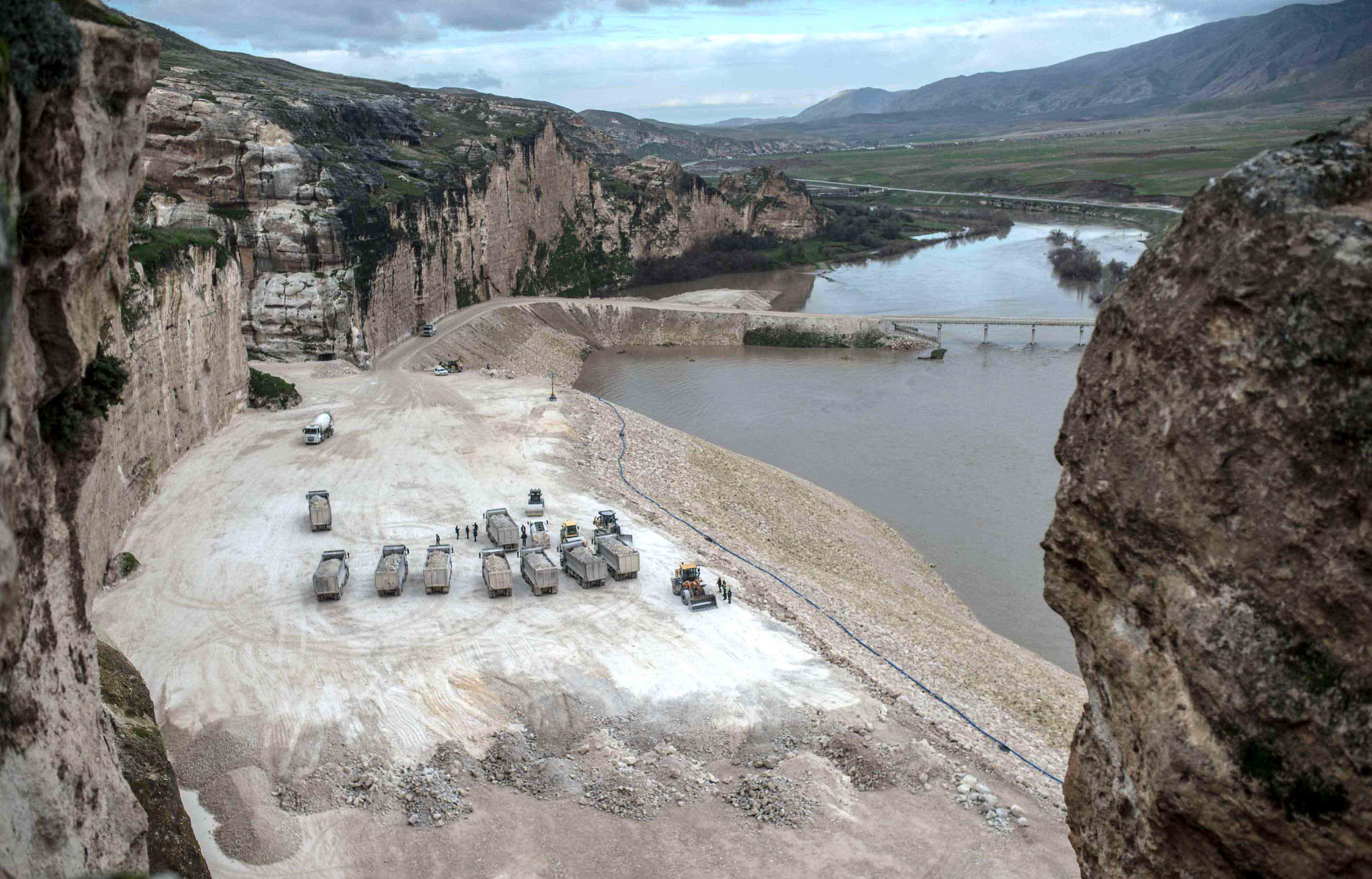 Trucks are seen on the banks of the Tigris River near Hasankeyf, last December. (AFP)
