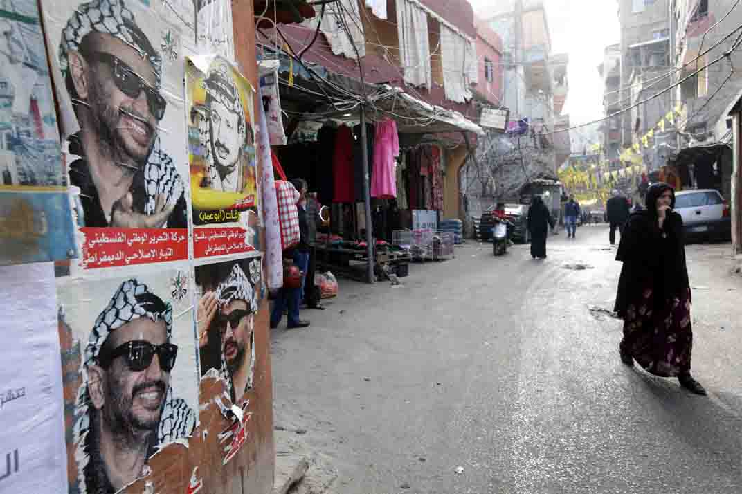 Posters of late Palestinian leader Yasser Arafat plastered on a wall in the Burj al-Barajneh refugee camp, a southern suburb of Beirut. (AFP)