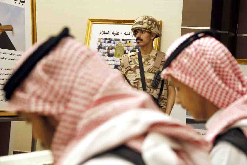 A Saudi soldier stands guard at the press centre for the Arab and Islamic summits in Mecca, May 30. (AP)