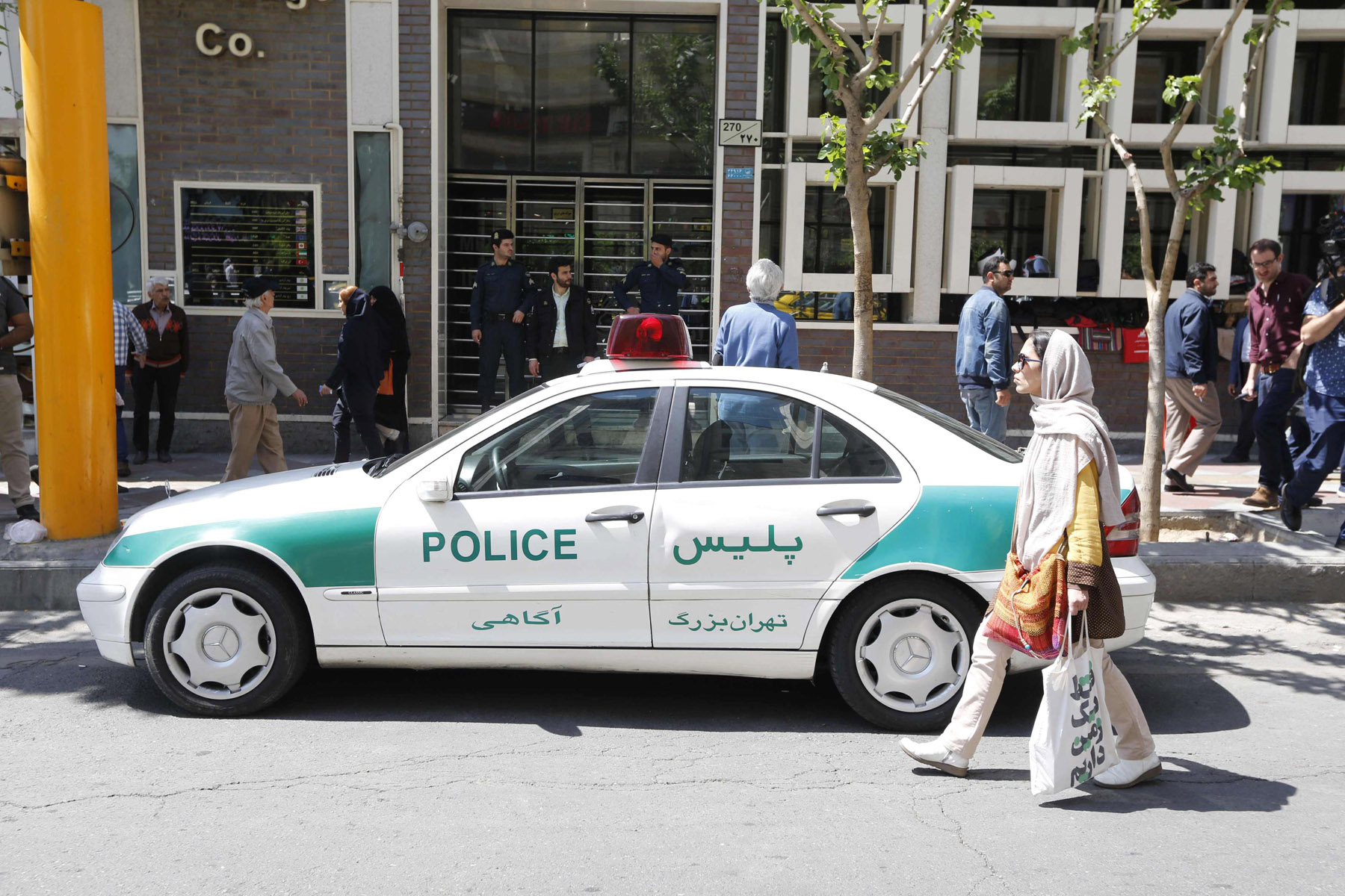 Flaunting rights. An Iranian police vehicle is seen parked outside a currency exchange shop in Tehran. (AFP)