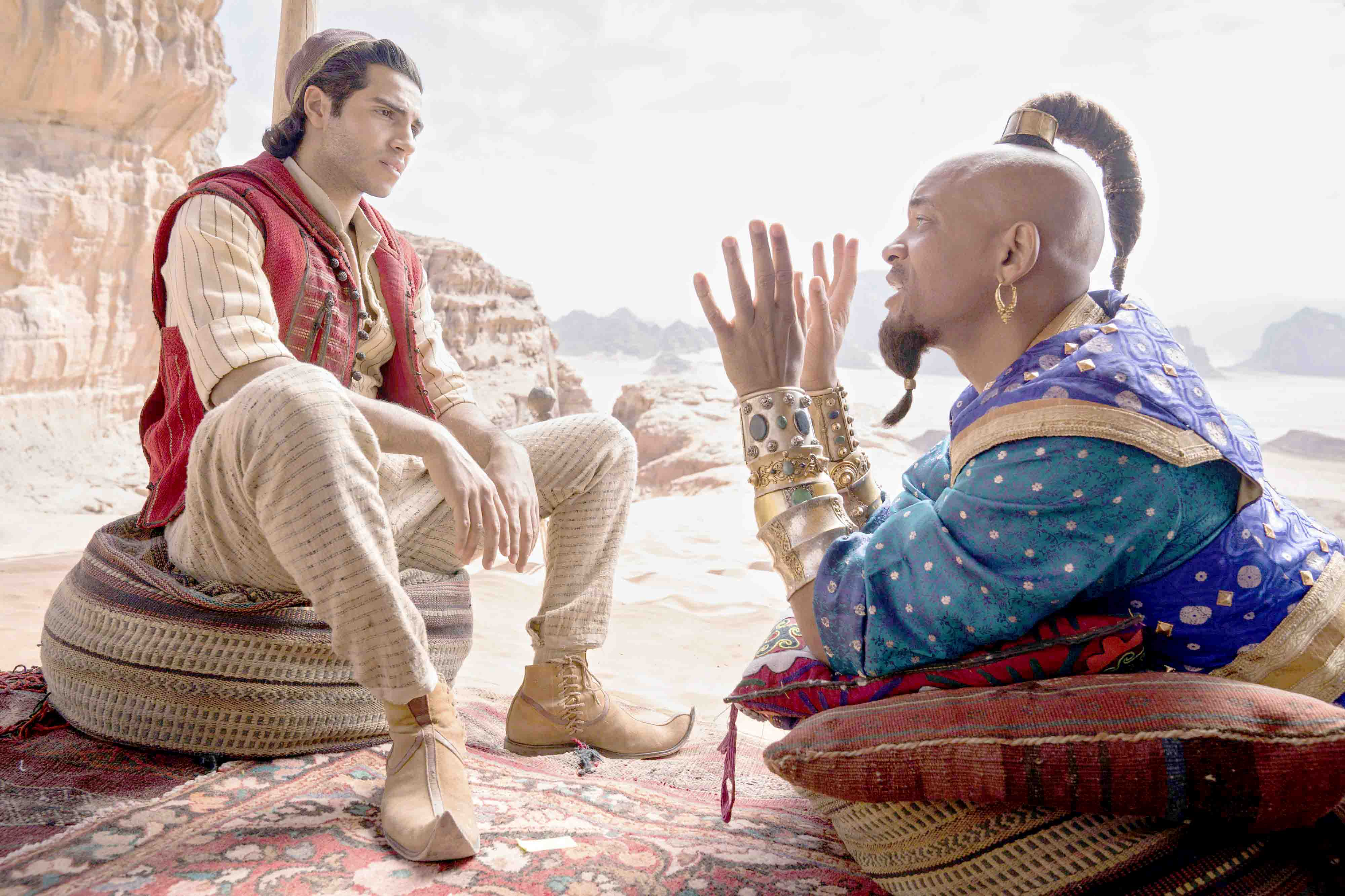 "A journey back to the desert. Mena Massoud as Aladdin (L) and Will Smith as Genie in Disney's live-action adaptation of the 1992 animated classic ""Aladdin.""(AP)"