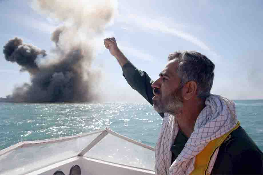 A member of Iran's Islamic Revolutionary Guard Corps chants slogans during a military drill in the Strait of Hormuz. (AFP)