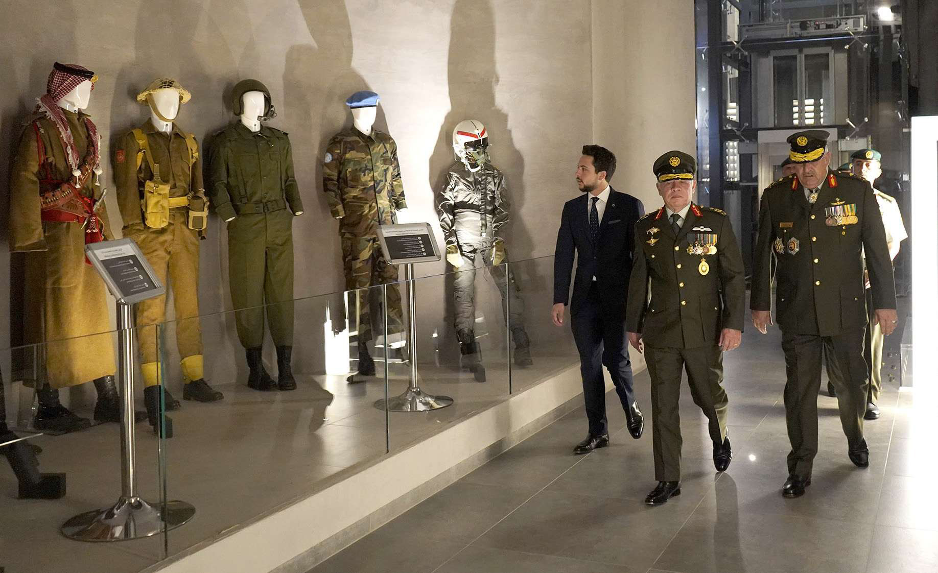 Jordanian King Abdullah II (2nd-R) and Crown Prince Hussein (3rd-R) view historical battle dress as they visit the Martyrs' Memorial museum in Amman, June 10. (Jordanian Royal Palace)