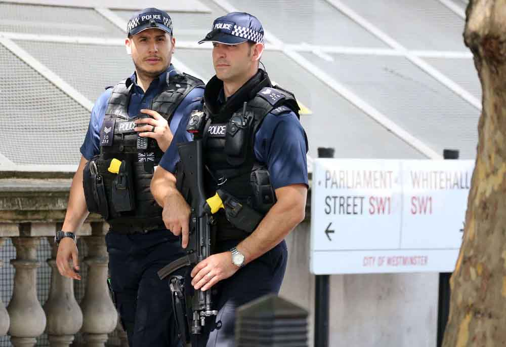 Hidden agenda? Armed British police officers patrol streets in London, May 23.(AFP)