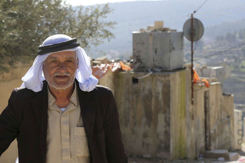 Dire conditions. A Palestinian man walks in Baqa'a refugee camp in northern Jordan. (AP)