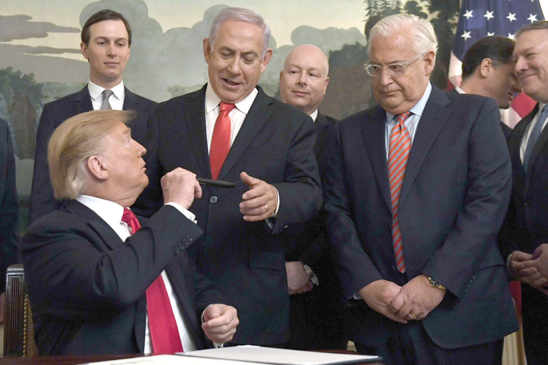 Undermined. President Donald Trump (Front-L) turns to Israeli Prime Minister Binyamin Netanyahu (C) after signing a proclamation at the White House in Washington,  last March. White House adviser Jared Kushner is first on the left.  (AP)