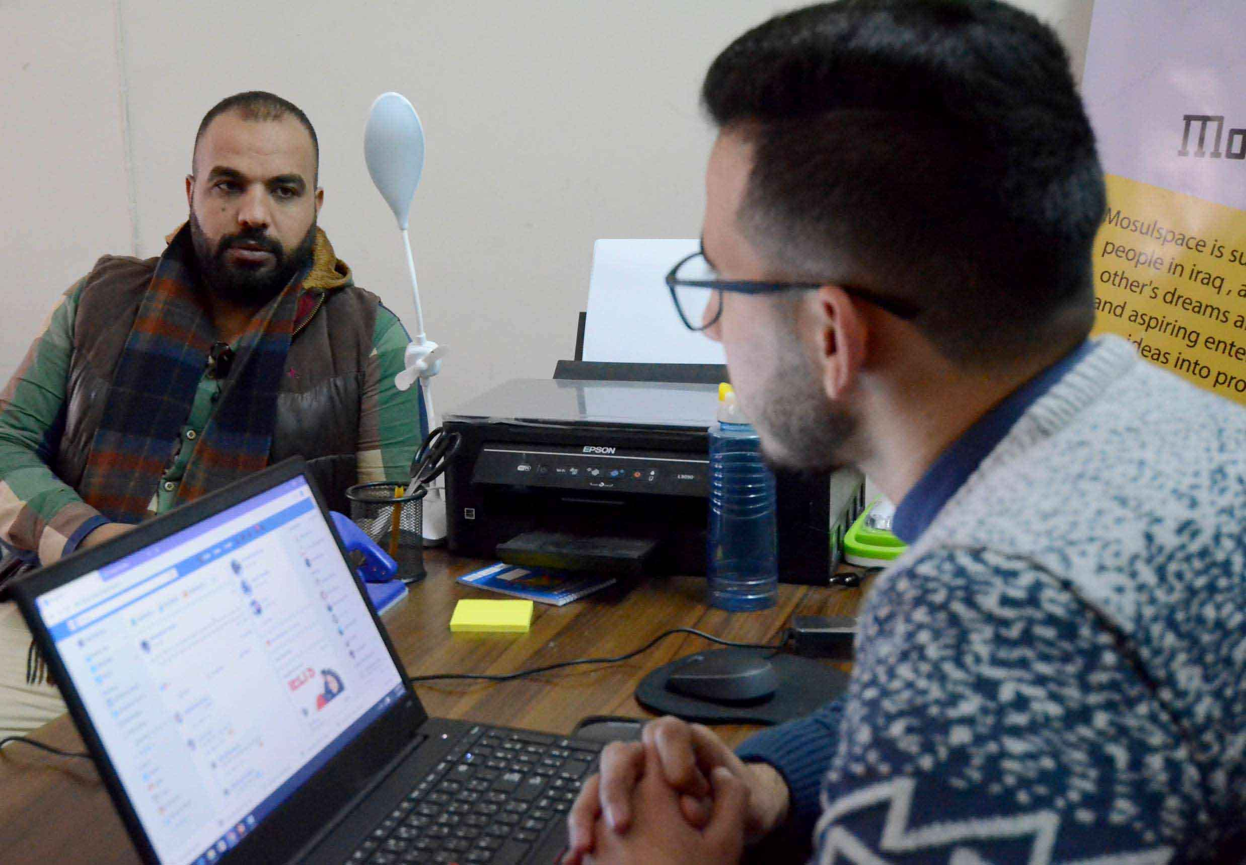 New world. Two Iraqi youth talk at Mosul incubator for would-be entrepreneurs. (AFP)