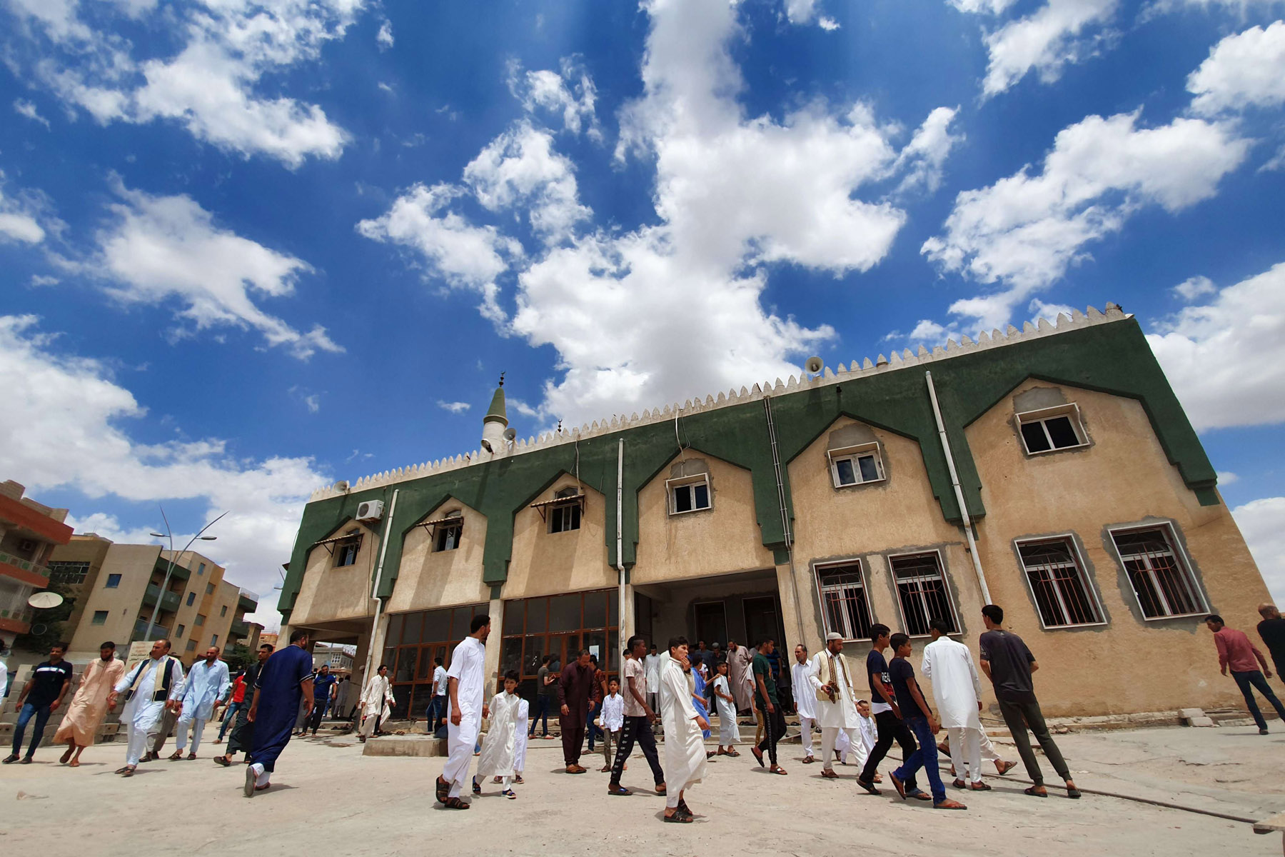 War goes on. Worshippers leave mosque after Friday prayers in Gharyan, June 28.  (AFP)