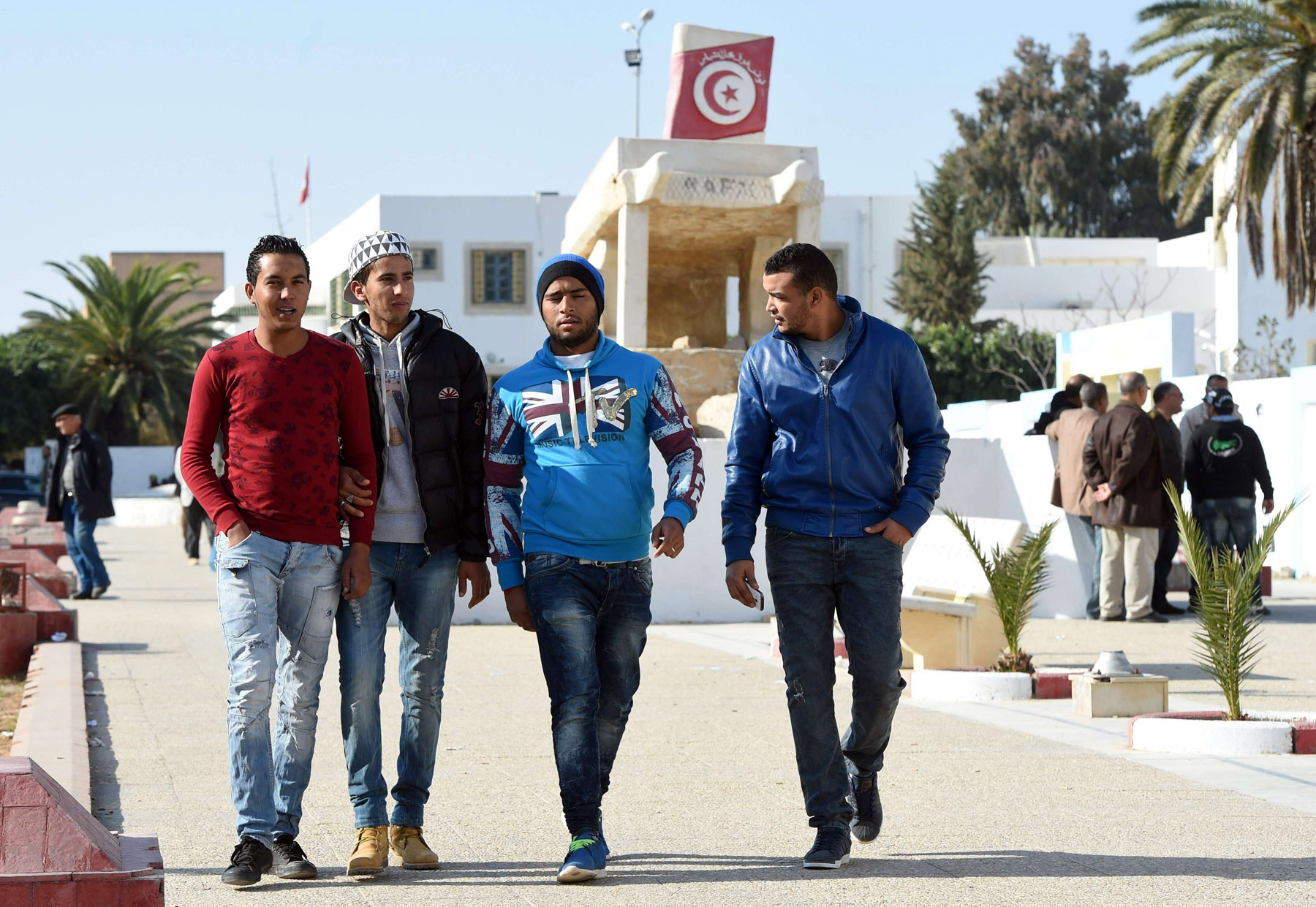 Tunisian graduates and unemployed youth walk in Mohamed Bouazizi square in the impoverished central town of Sidi Bouzid. (AFP)
